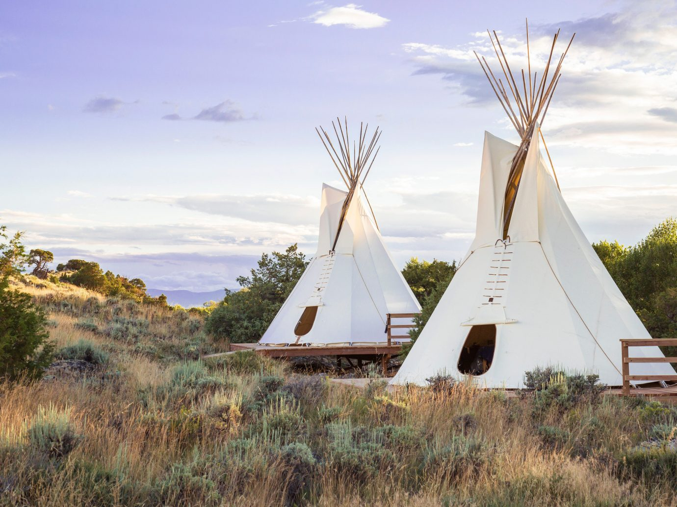 Outdoors + Adventure Trip Ideas tepee building grass outdoor sky windmill landmark field rural area mill tower monument wind