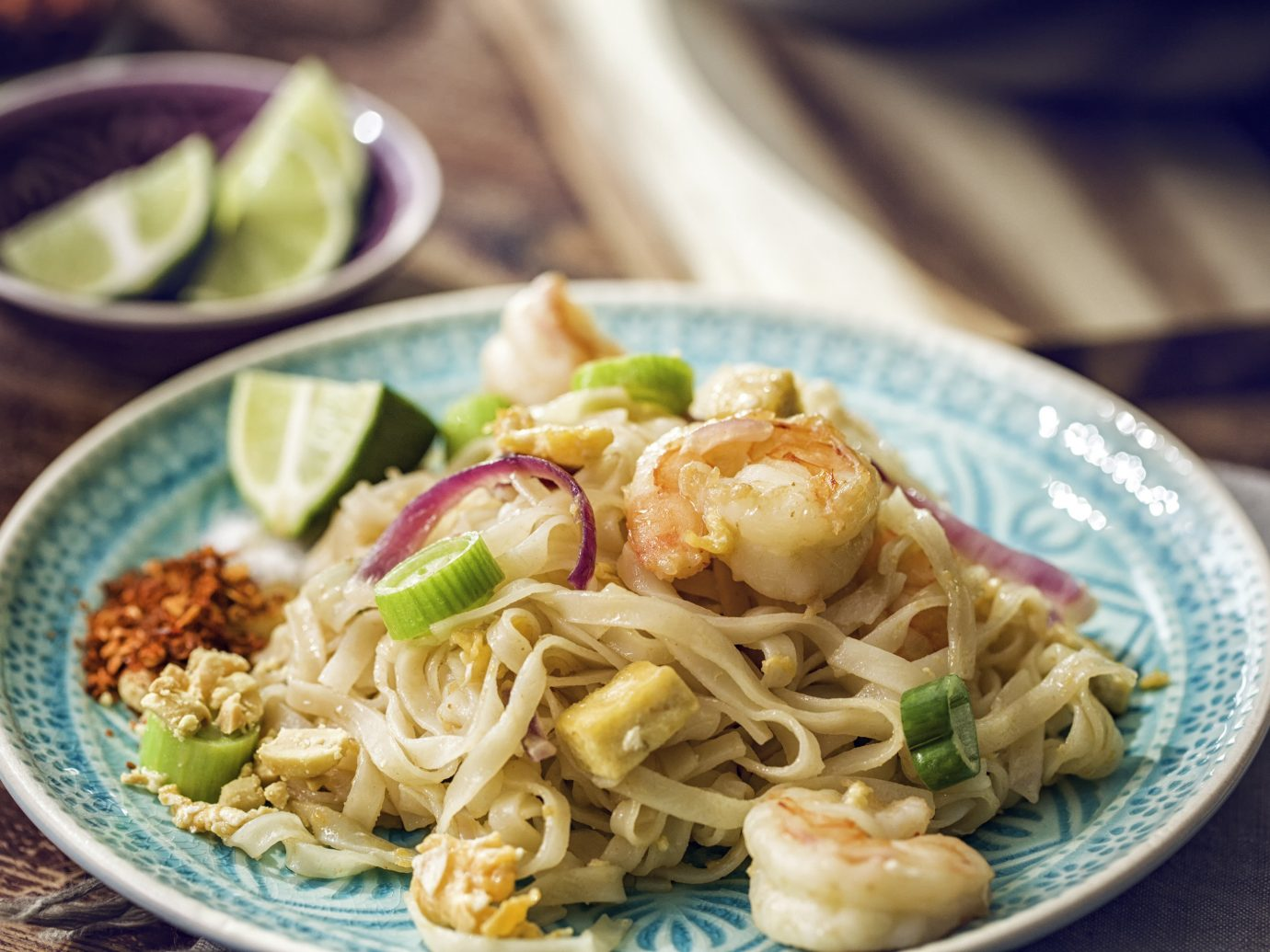 Jetsetter Guides plate food table dish cuisine noodle soup pad thai asian food noodle thai food chinese food chow mein southeast asian food Seafood laksa produce bakmi pasta