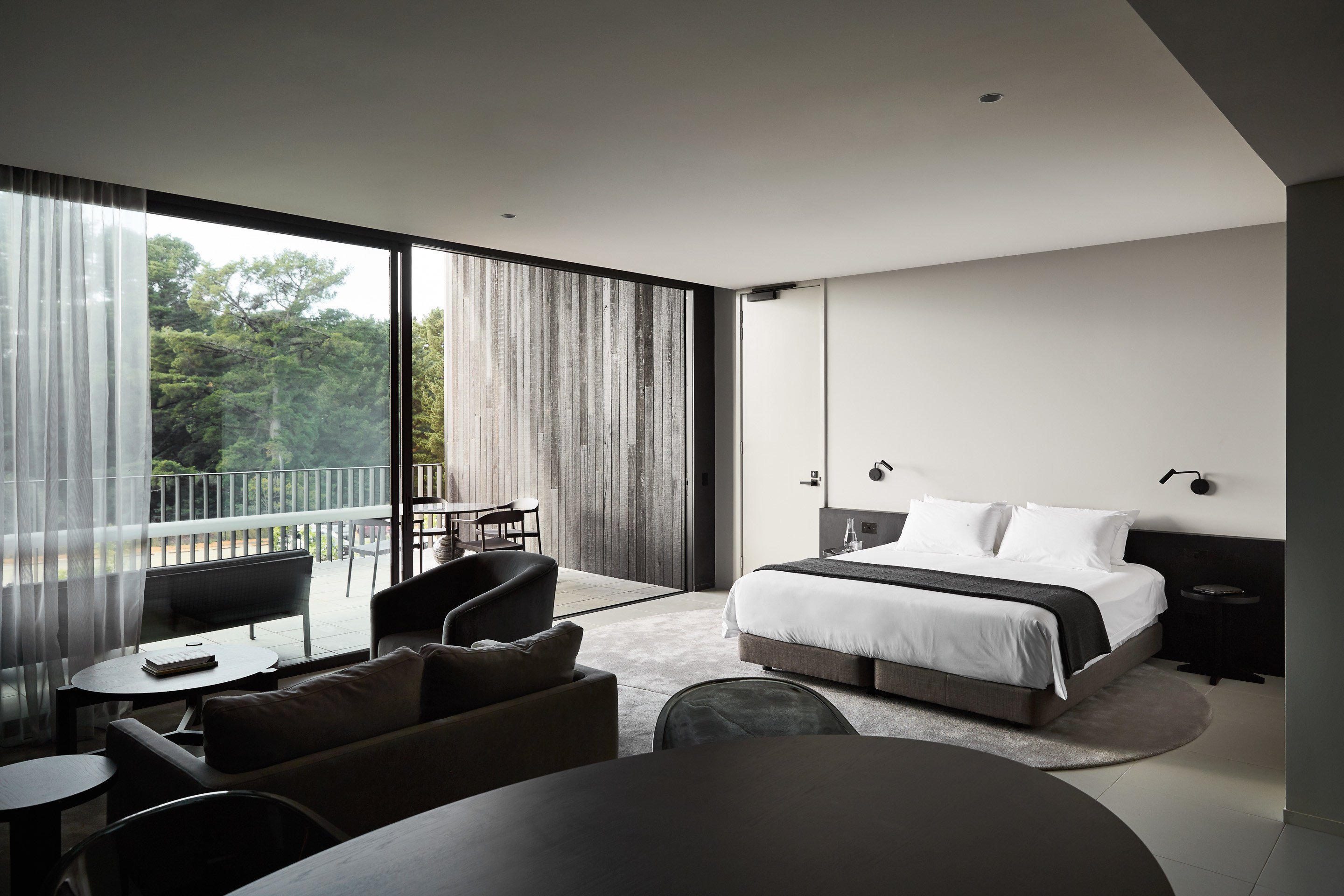Food + Drink Hotels Trip Ideas Winter indoor sofa wall window ceiling bed room floor hotel Bedroom interior design property Architecture house real estate Suite living room daylighting condominium interior designer furniture pillow penthouse apartment apartment Modern decorated