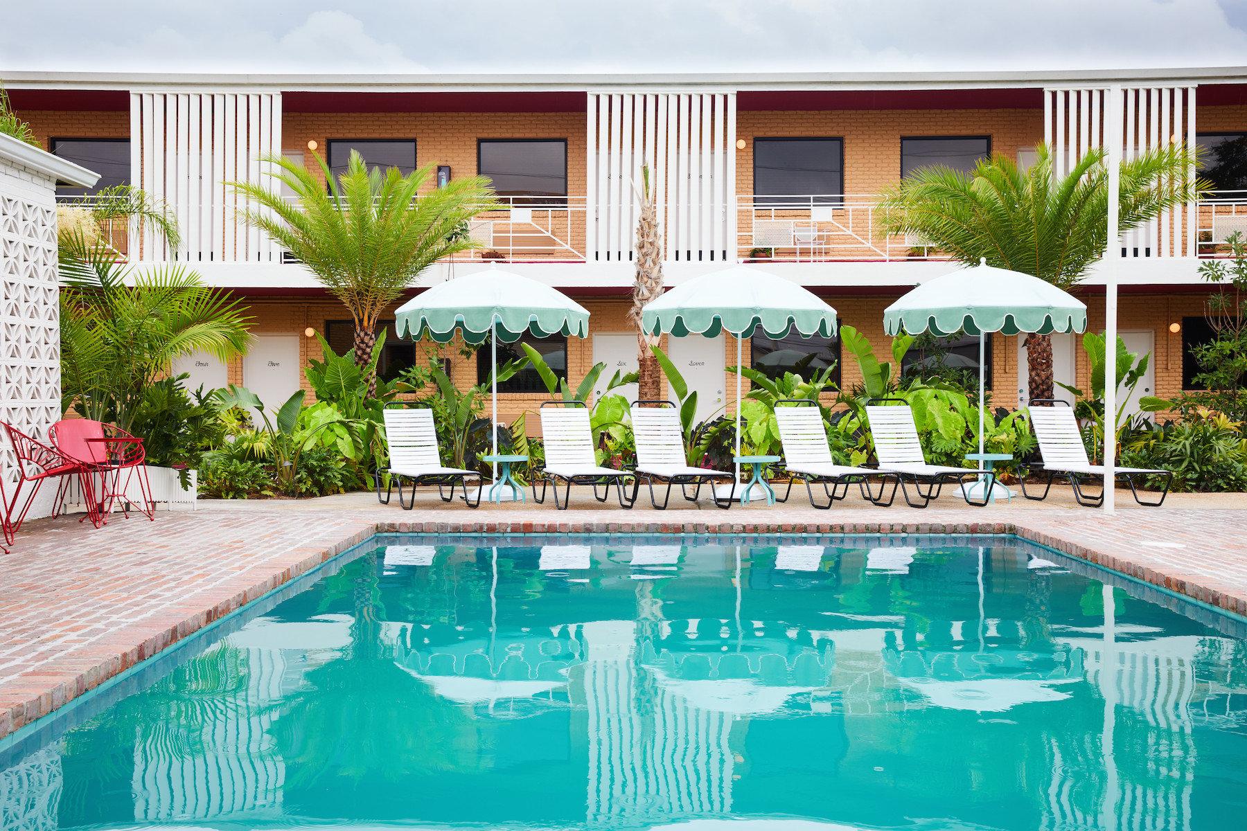 Boutique Hotels Hotels Luxury Travel building outdoor swimming pool Resort property leisure real estate estate Pool Villa hotel hacienda condominium vacation house palm tree backyard apartment amenity
