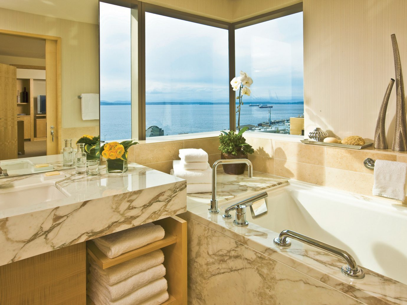 Bath Elegant Hotels Modern Scenic views Waterfront indoor bathroom window room sink property estate home counter interior design floor countertop Suite real estate apartment Villa tub bathtub