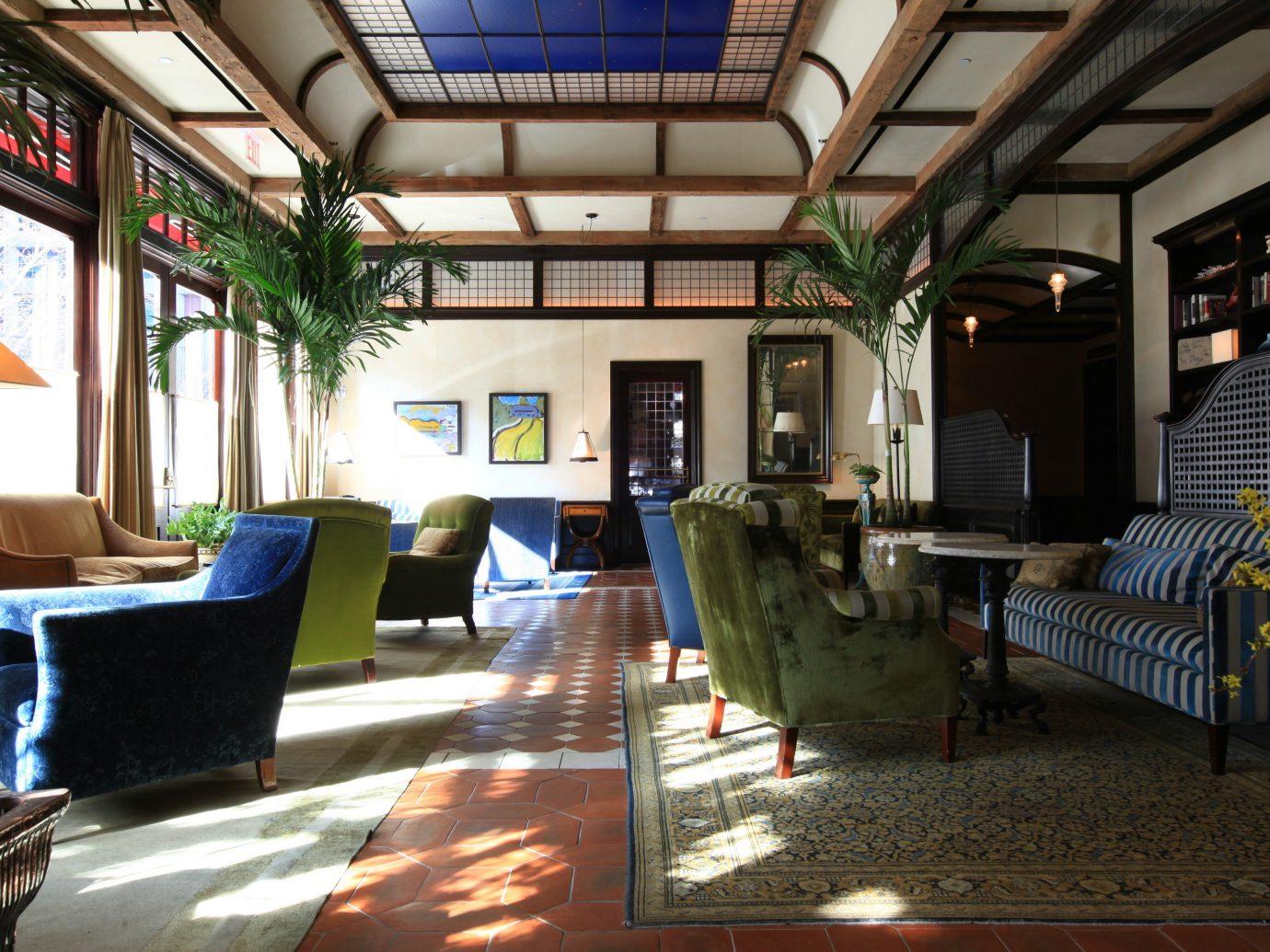 Celebs Hotels indoor Living room floor chair interior design living room real estate furniture Lobby estate loft area