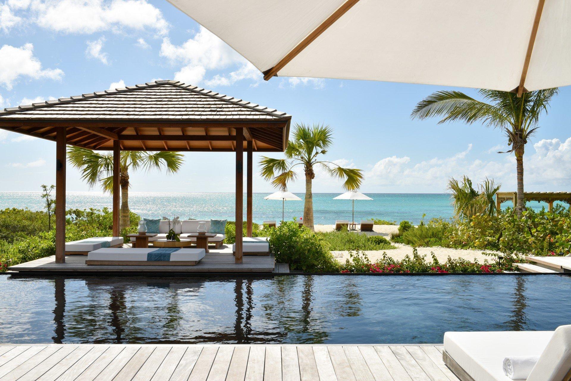 Hotels sky outdoor tree water swimming pool leisure property Resort vacation estate Villa condominium caribbean cottage overlooking Deck shore shade