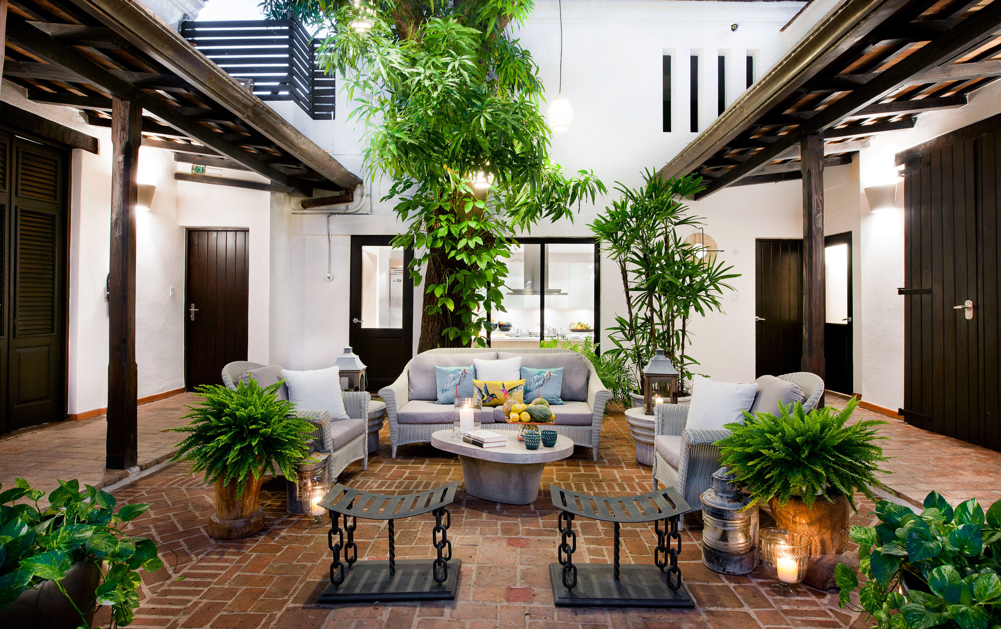 Boutique Courtyard Historic Hotels Lounge Outdoors Patio property room home building estate living room house porch plant backyard real estate outdoor structure condominium interior design cottage farmhouse Villa Design mansion furniture