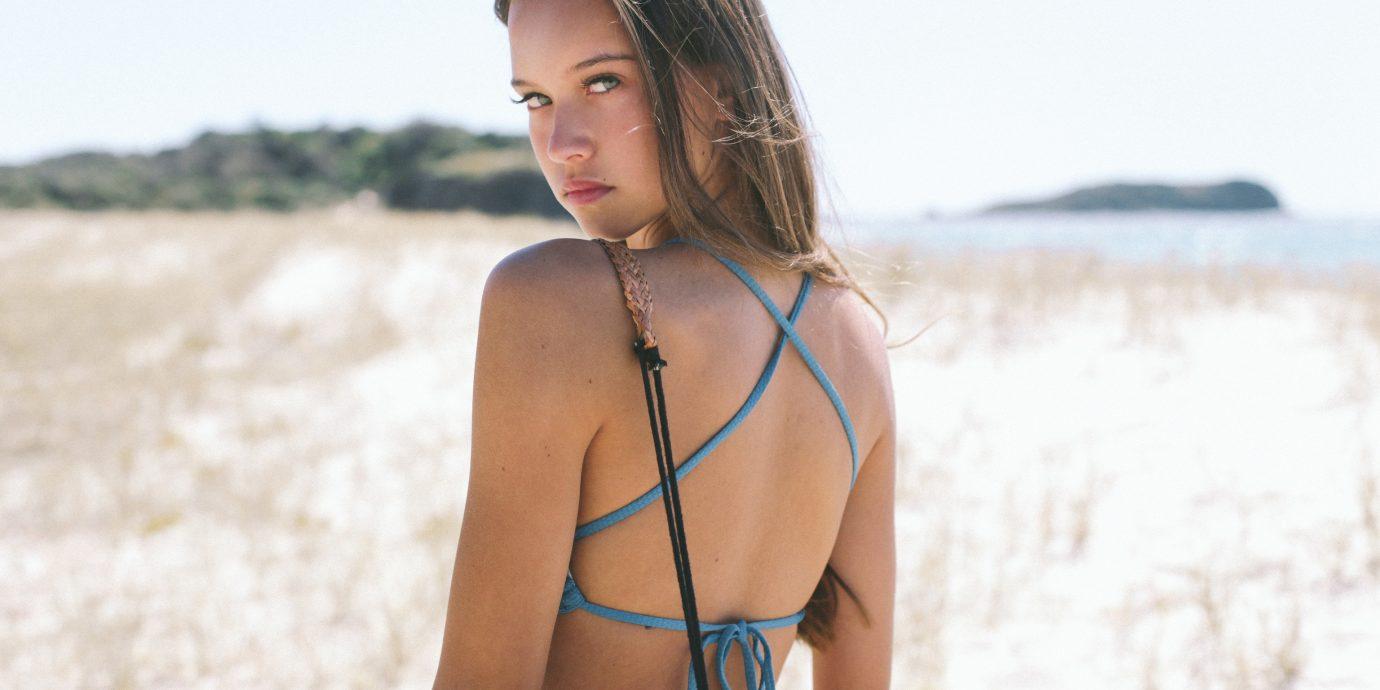 Style + Design outdoor person Beach water clothing swimwear swimsuit Beauty board undergarment model supermodel photo shoot carrying long hair leg beautiful
