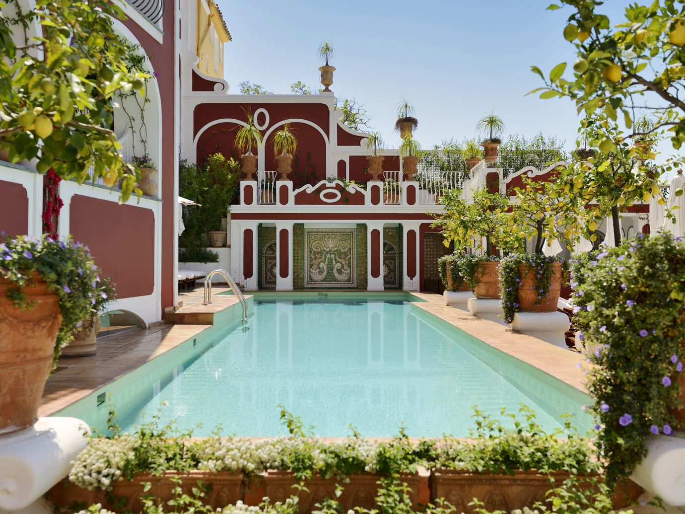 calm charming europe Greenery Hotels Jetsetter Guides Luxury outdoor pool Pool quaint remote serene summer tree outdoor property estate swimming pool mansion home Villa hacienda backyard Resort Courtyard palace real estate Garden