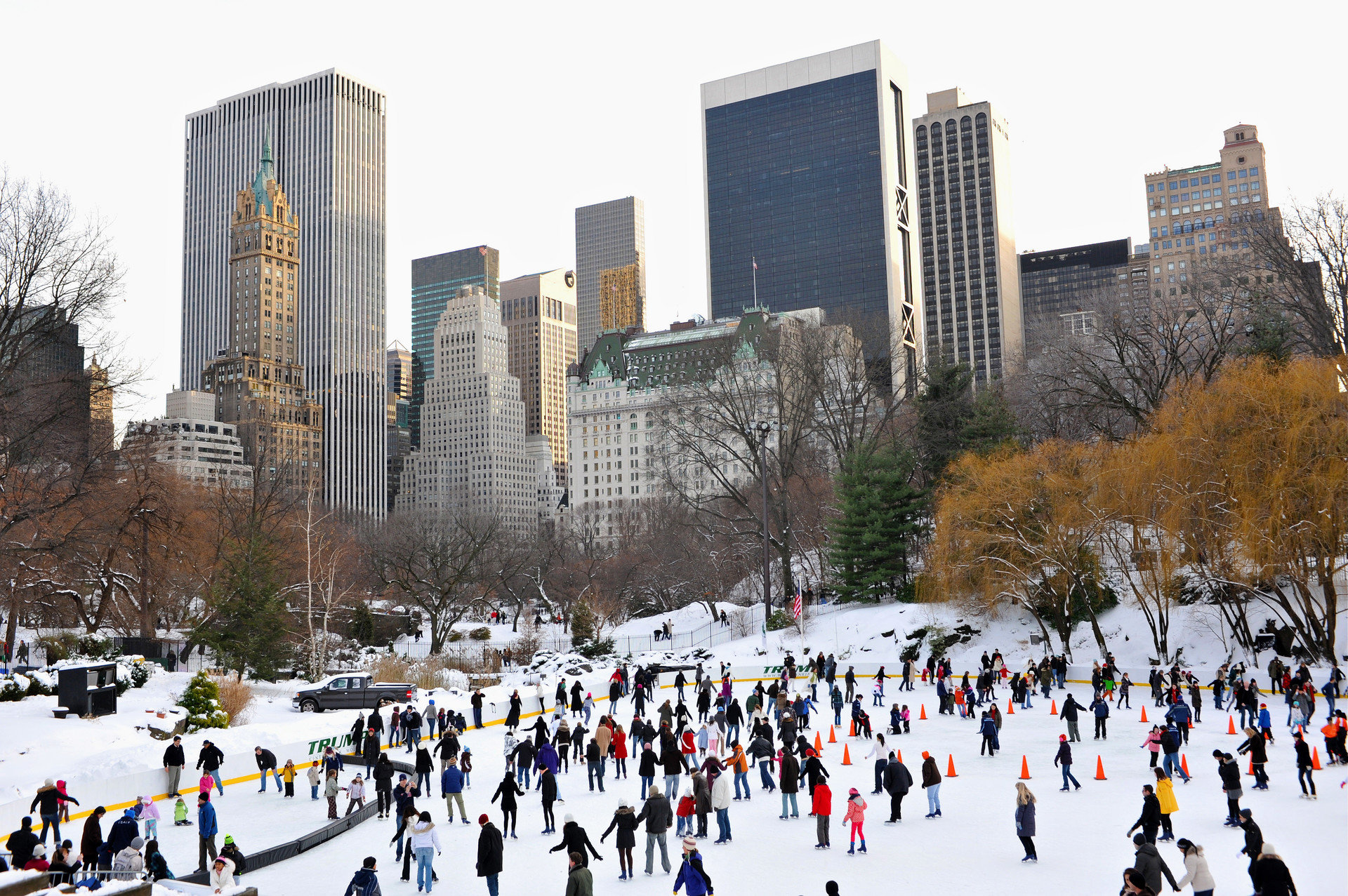 Trip Ideas outdoor rink tree group people skiing Winter City season snow winter sport ice rink sports skyline line crowd