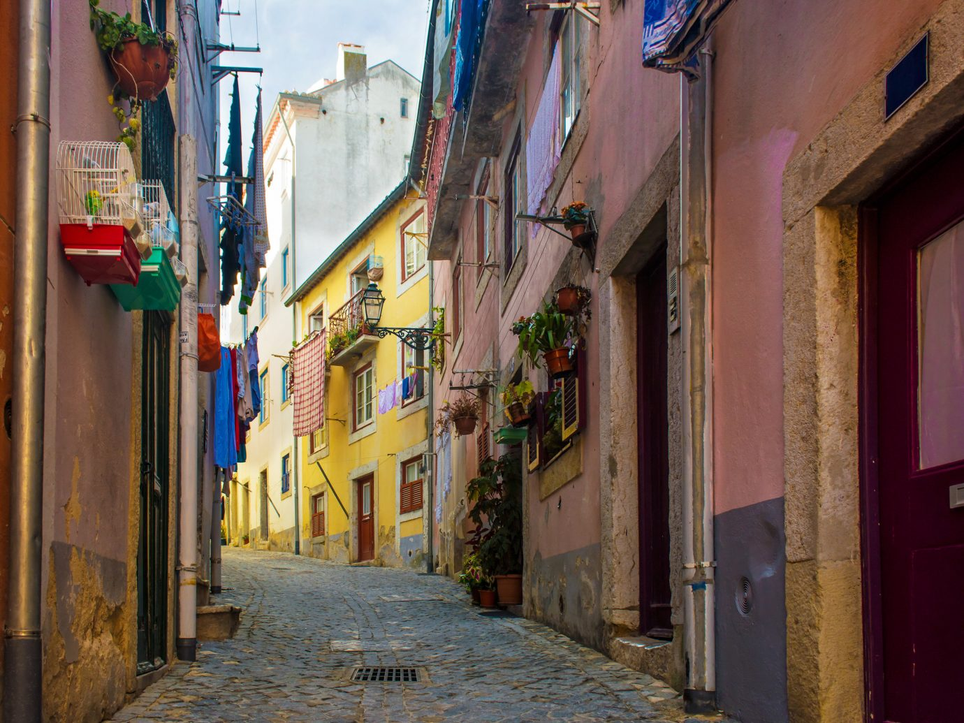 Lisbon Portugal Trip Ideas alley Town neighbourhood street infrastructure road wall City window sky facade house building