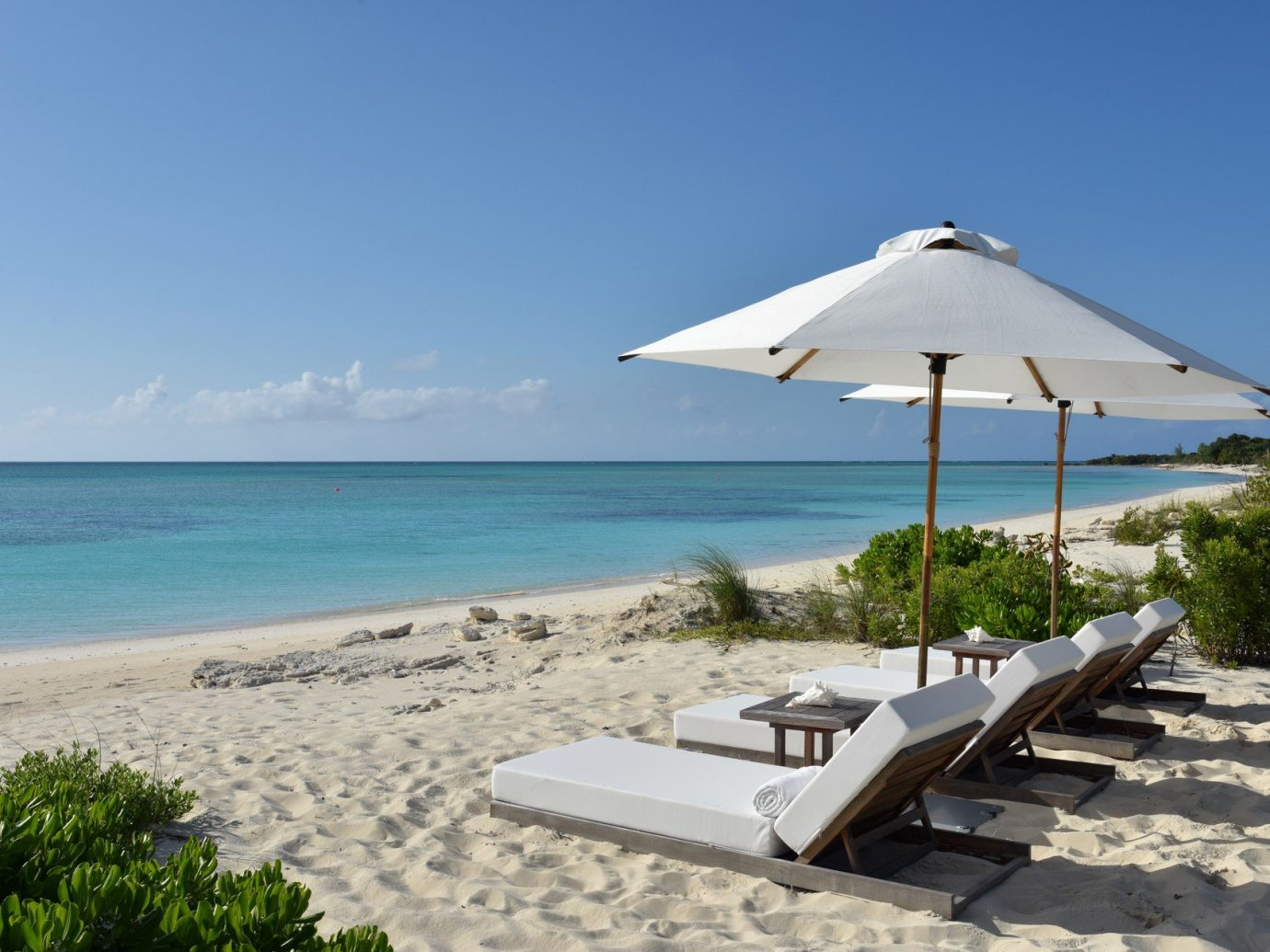 News Trip Ideas sky outdoor umbrella water Beach Nature chair Sea shore Ocean vacation Coast lawn caribbean cape bay Resort wind sandy shade day