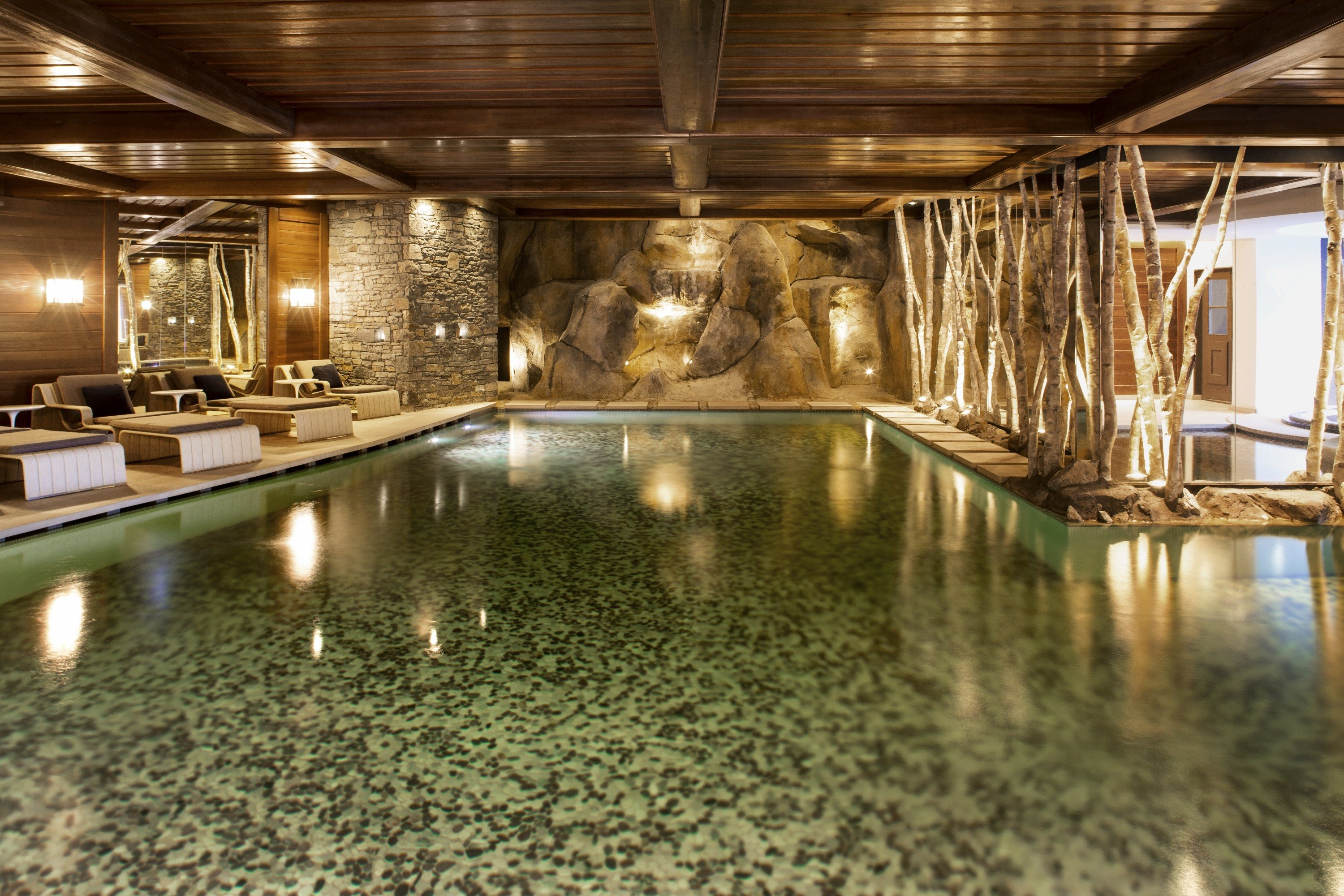 Hotels Luxury Travel Mountains + Skiing ceiling indoor floor swimming pool estate thermae lighting reflection several