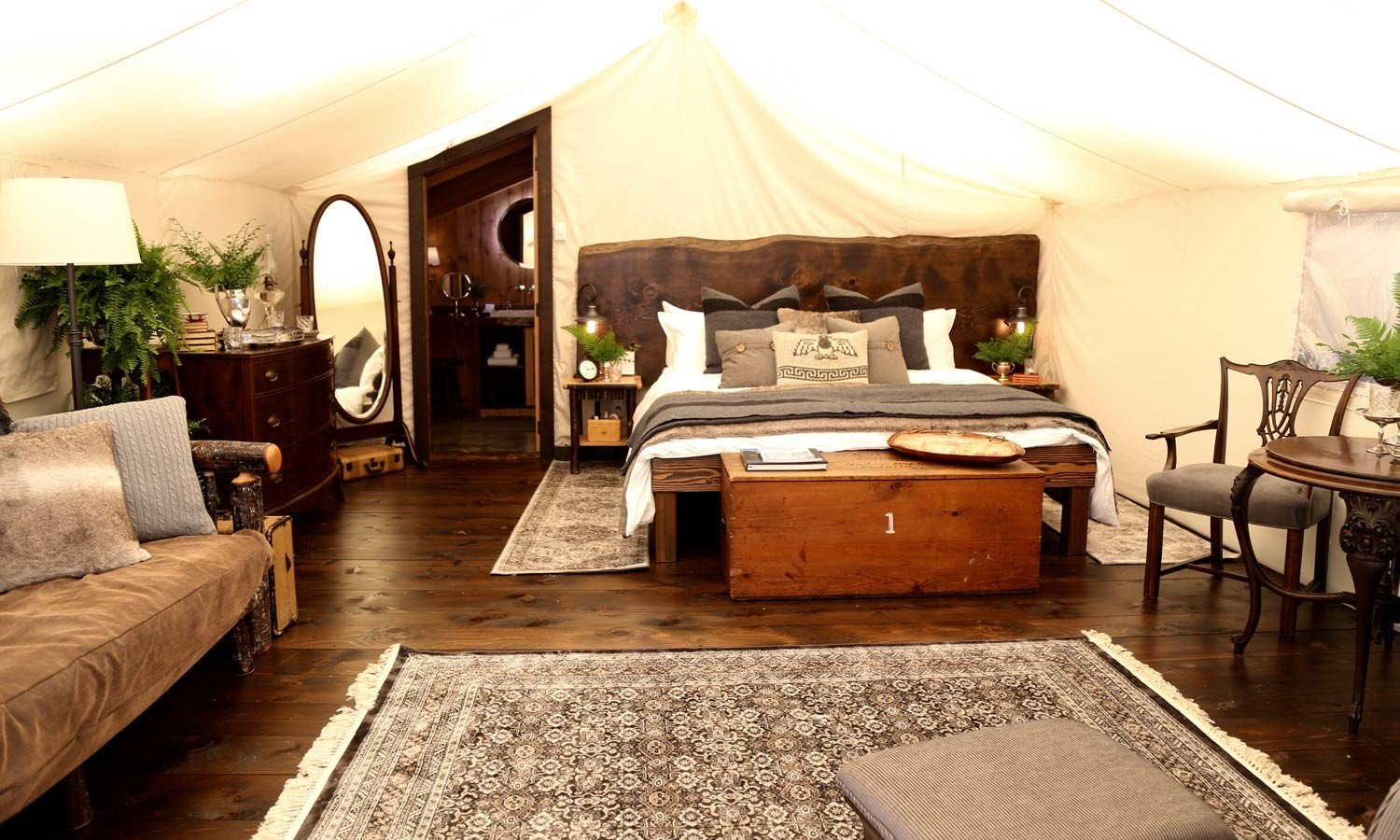 Glamping Luxury Travel Outdoors + Adventure Trip Ideas Weekend Getaways floor indoor room Living sofa furniture Bedroom bed bed frame interior design flooring wood mattress estate Suite hardwood area decorated