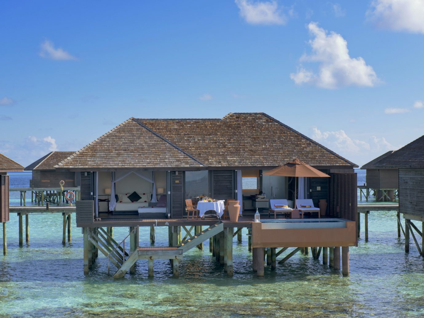 All-Inclusive Resorts Hotels sky outdoor ground Resort house property chair wooden real estate vacation swimming pool estate leisure Sea Lagoon Villa home cottage water hut tourism tropics Ocean area empty several