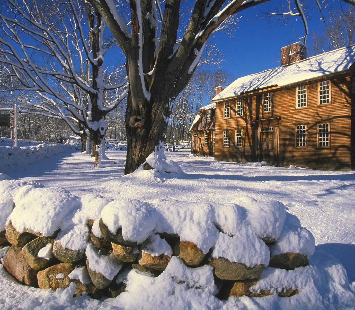Weekend Getaways snow tree outdoor Winter blue sky freezing house home frost log cabin ice landscape facade evening branch surrounded