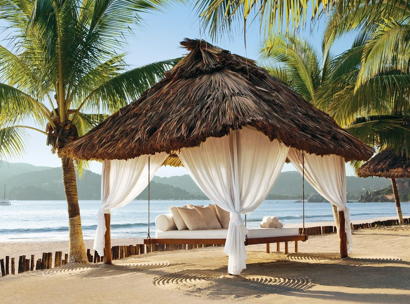 Zihuatanejo mexico lawn hut on sandy beach