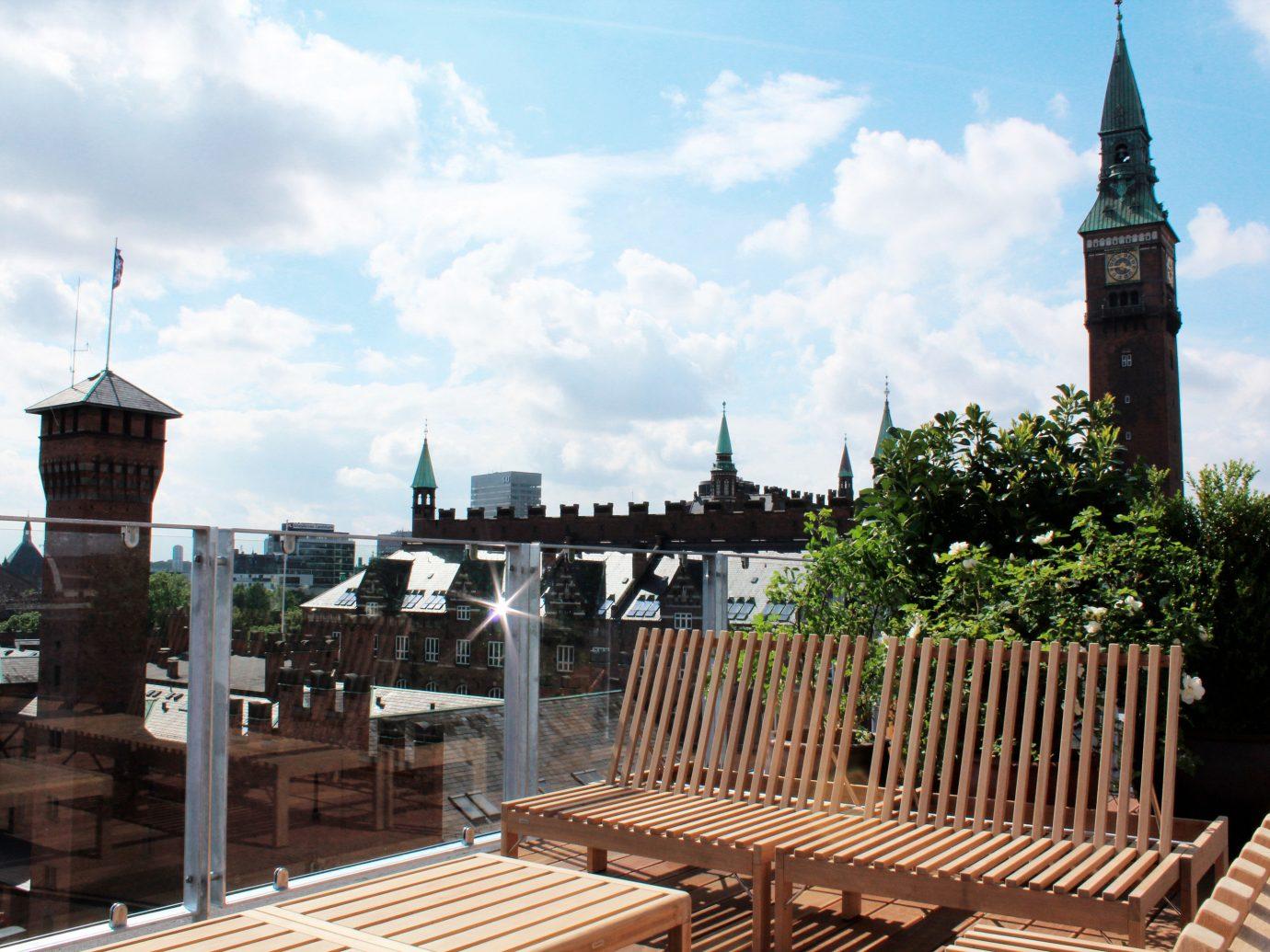 Boutique Hotels Copenhagen Denmark Hotels sky outdoor landmark outdoor structure tree roof City building spire plaza steeple day