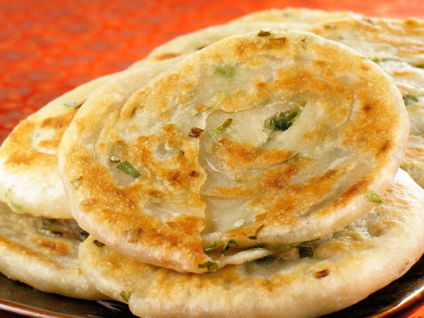 Trip Ideas food dish naan cuisine hotteok breakfast baked goods pupusa bread roti flatbread meal roti prata roti canai paratha produce tortilla de patatas indian cuisine khachapuri