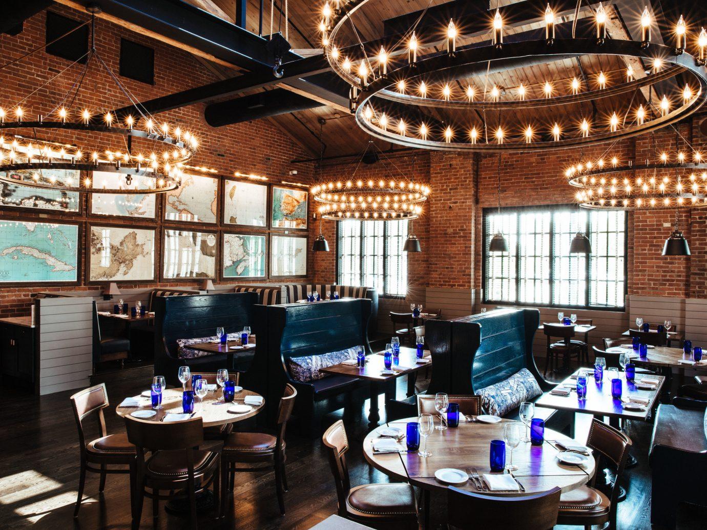 Food + Drink indoor table ceiling floor room building restaurant meal interior design furniture several