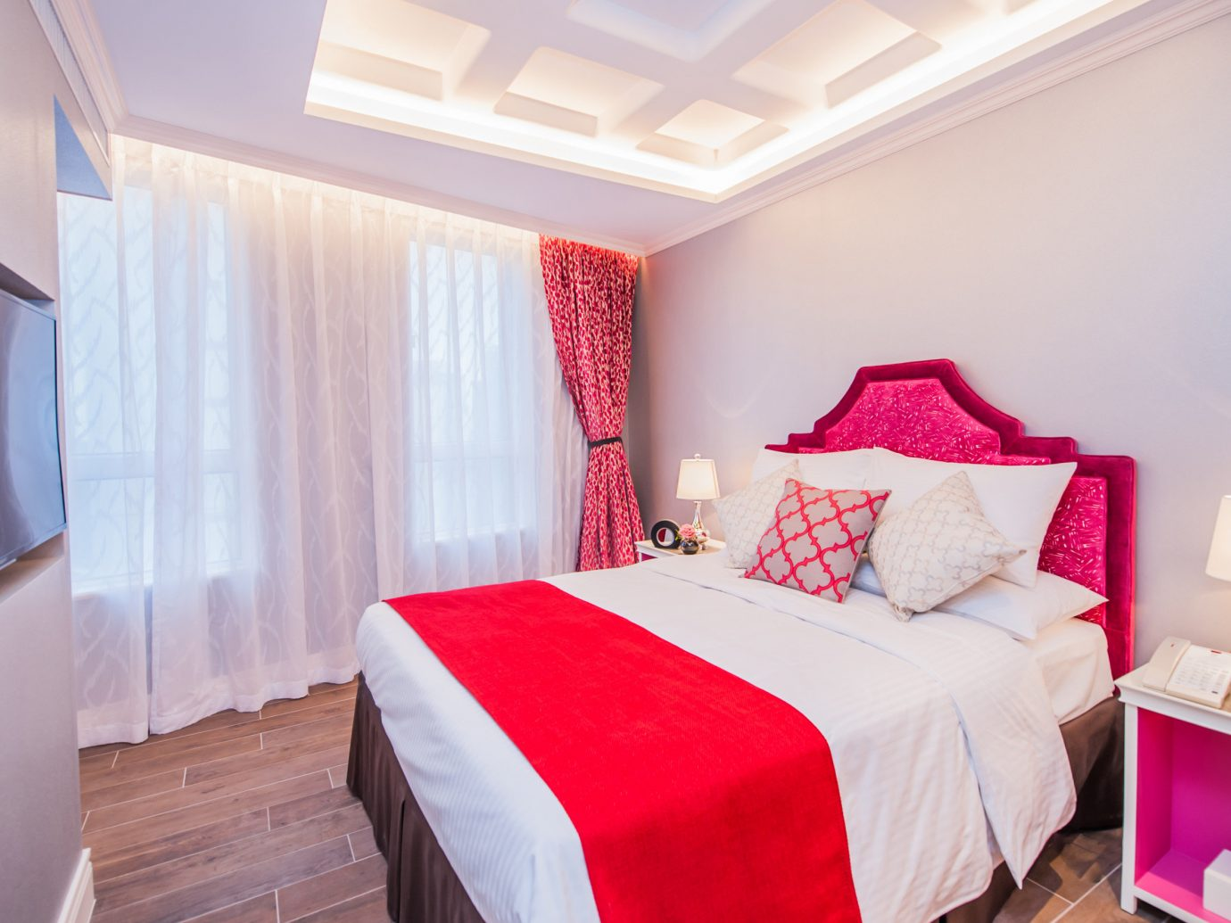 Hotels wall bed indoor red floor room Bedroom property Suite white cottage interior design bed sheet real estate apartment