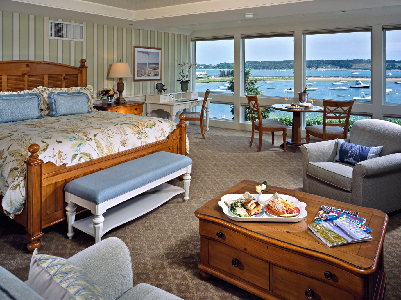 Bedroom Food + Drink Hotels Living Lounge Luxury Travel Resort Scenic views Trip Ideas Waterfront Weekend Getaways indoor floor room window property estate passenger ship ceiling yacht Suite home cottage furniture real estate living room interior design Villa apartment several