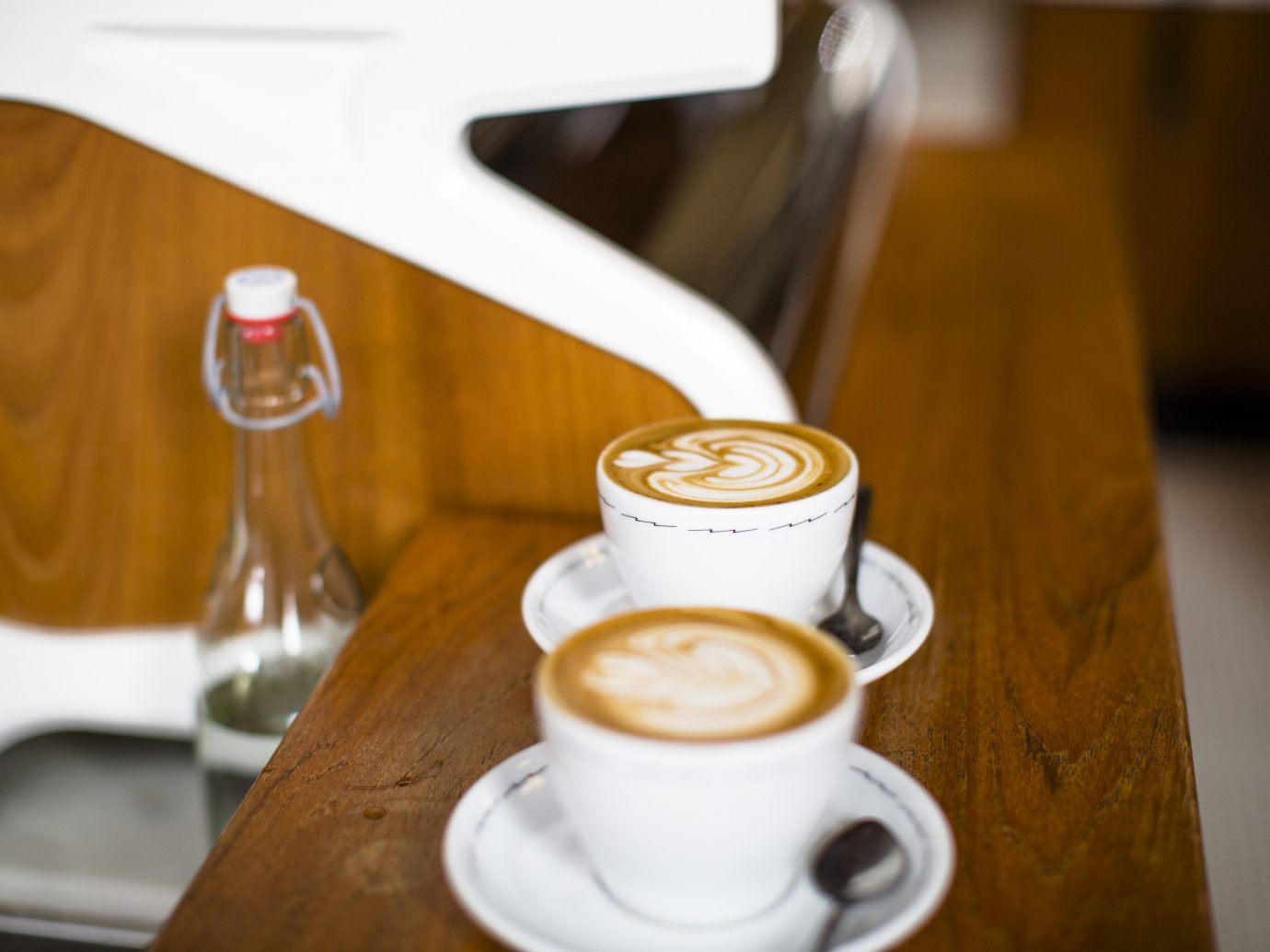 Food + Drink Offbeat Travel Trends cup table coffee indoor cappuccino espresso caffè macchiato wiener melange latte flat white Drink cortado café au lait ristretto café coffee cup doppio mocaccino cuban espresso caffeine flavor caffè americano coffeehouse coffee milk