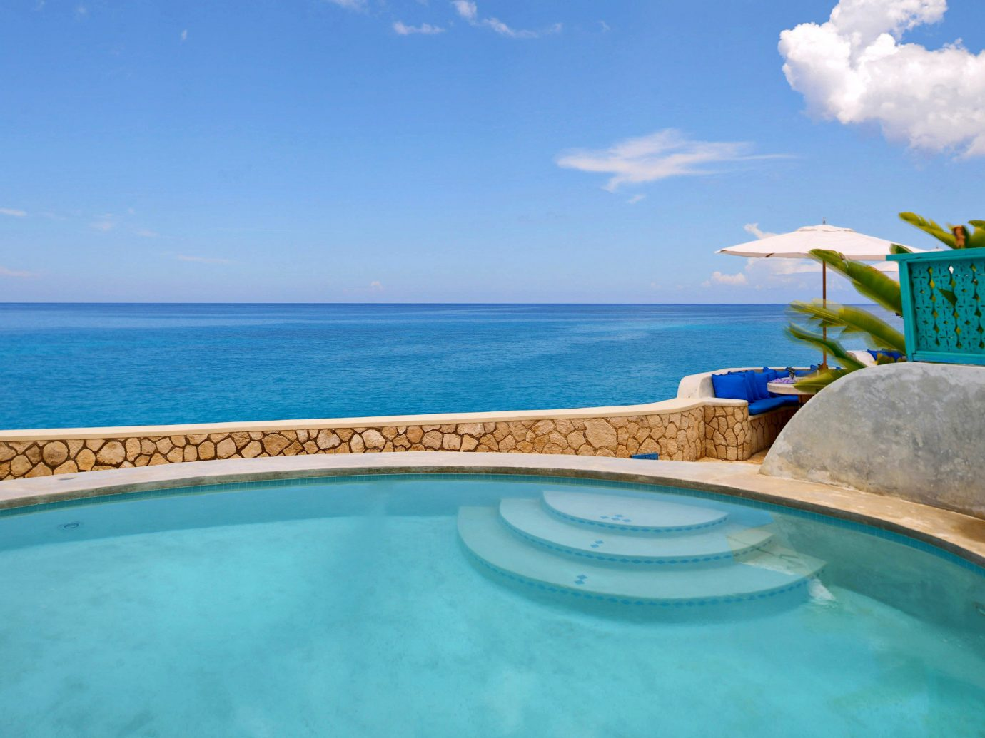 Luxury Pool Romance Romantic Scenic views Trip Ideas Tropical Waterfront sky water outdoor swimming pool property caribbean vacation Nature Sea estate Ocean Villa Lagoon shore Resort swimming
