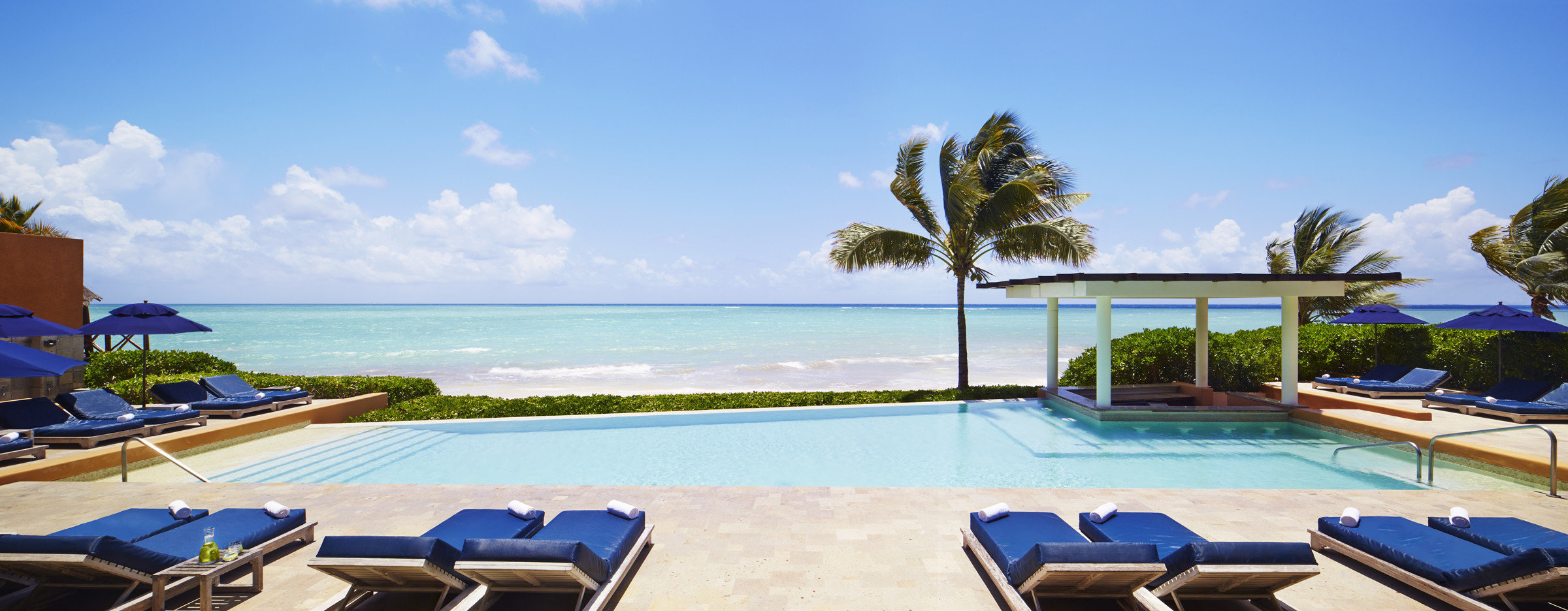 Hotels Romance sky water outdoor leisure swimming pool property Beach Resort vacation estate Villa caribbean real estate bay Deck day shore