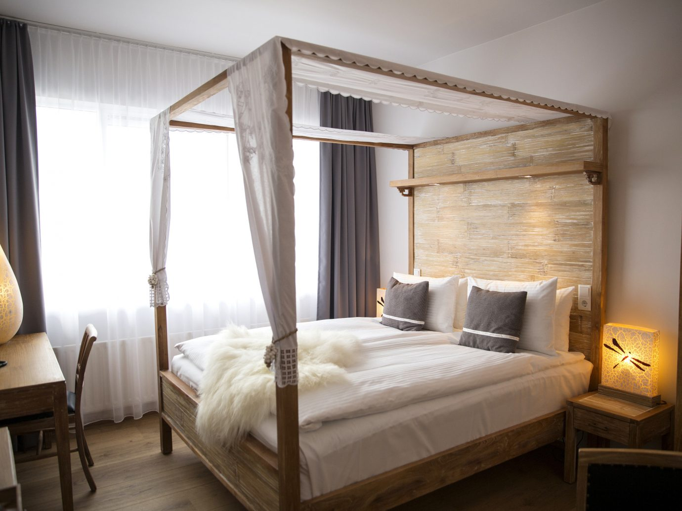 Boutique Hotels Hotels Iceland Reykjavík indoor wall floor bed bed frame room Suite Bedroom interior design ceiling furniture four poster mattress wood window window treatment hotel bed sheet window covering bedding interior designer