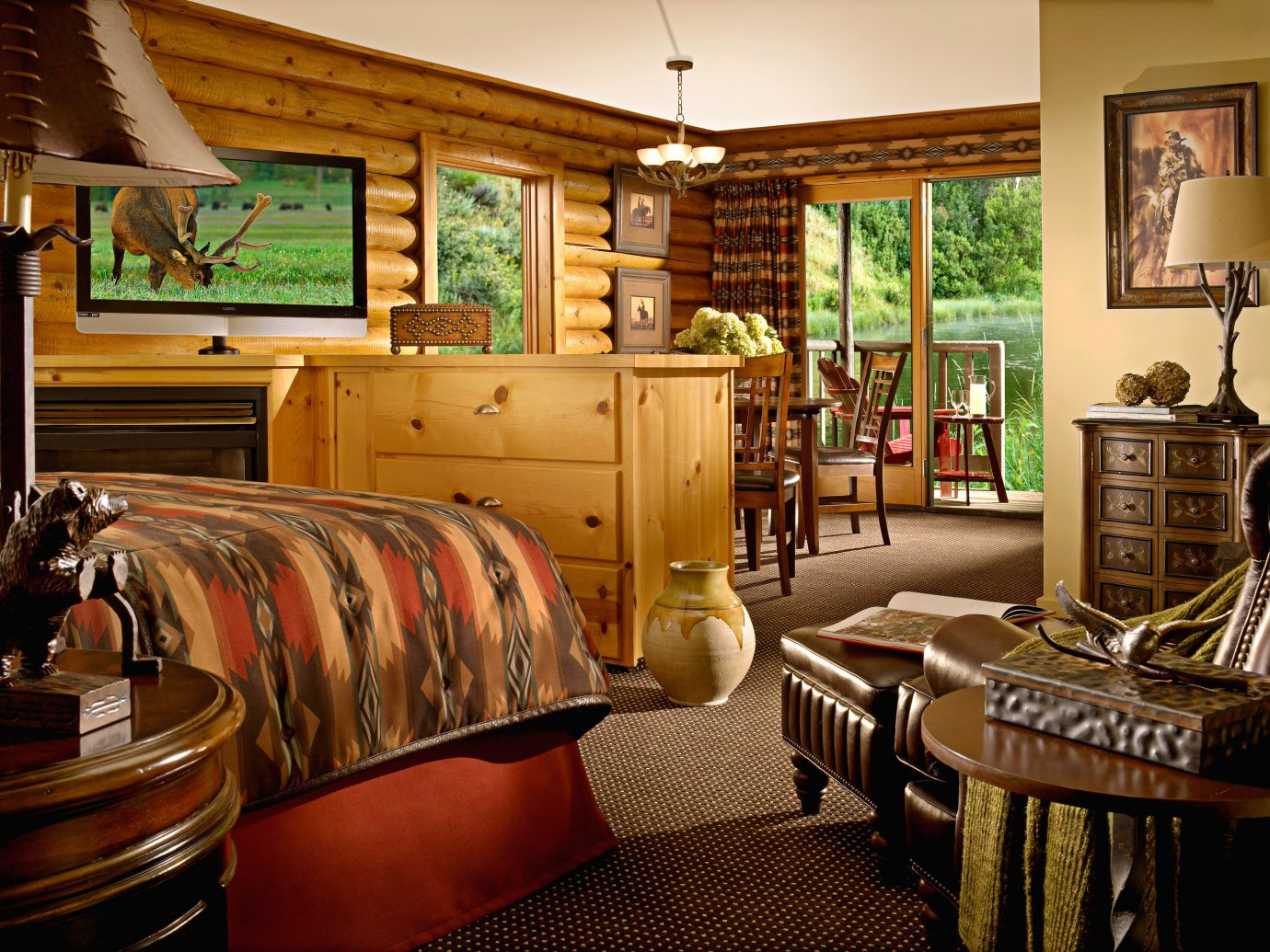Adventure Bedroom Boat Budget Country Family Forest Lake Lodge Mountains Outdoor Activities Outdoors River Rustic indoor room property Living chair dining room living room estate home interior design real estate furniture area several