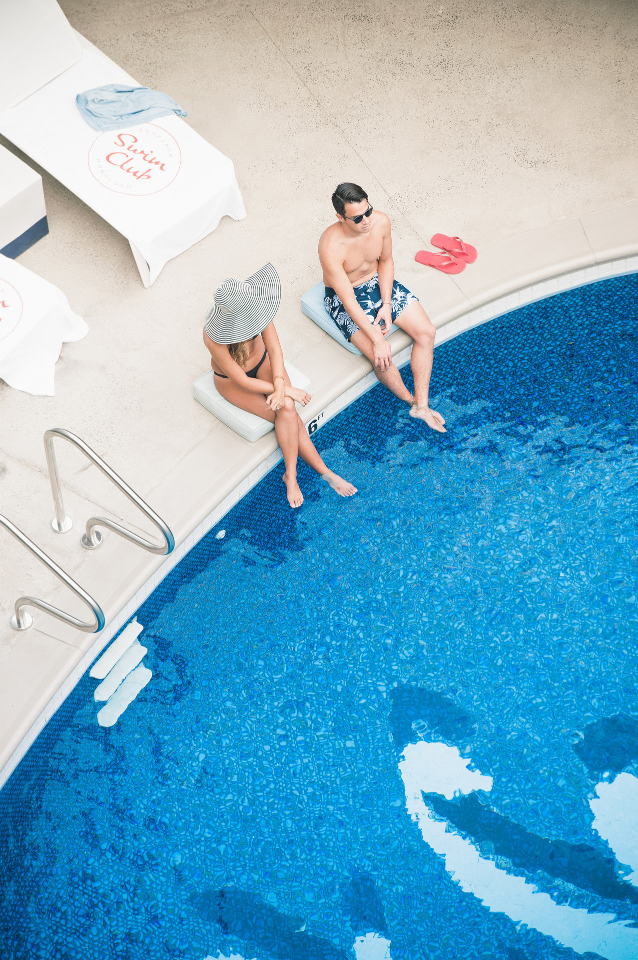 aerial Boutique couple Hotels lounge chairs Luxury nautical outdoor pool people Pool relaxation relaxing Romance Romantic sophisticated floor blue swimming pool leisure