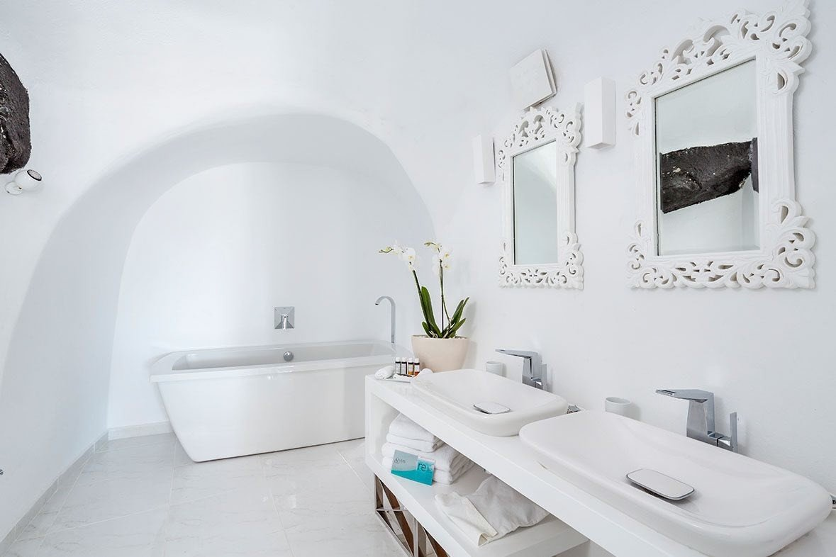Greece Hotels Luxury Travel Santorini wall indoor bathroom sink room property tap toilet interior design home product design plumbing fixture floor bidet bathroom sink toilet seat ceramic interior designer Bath