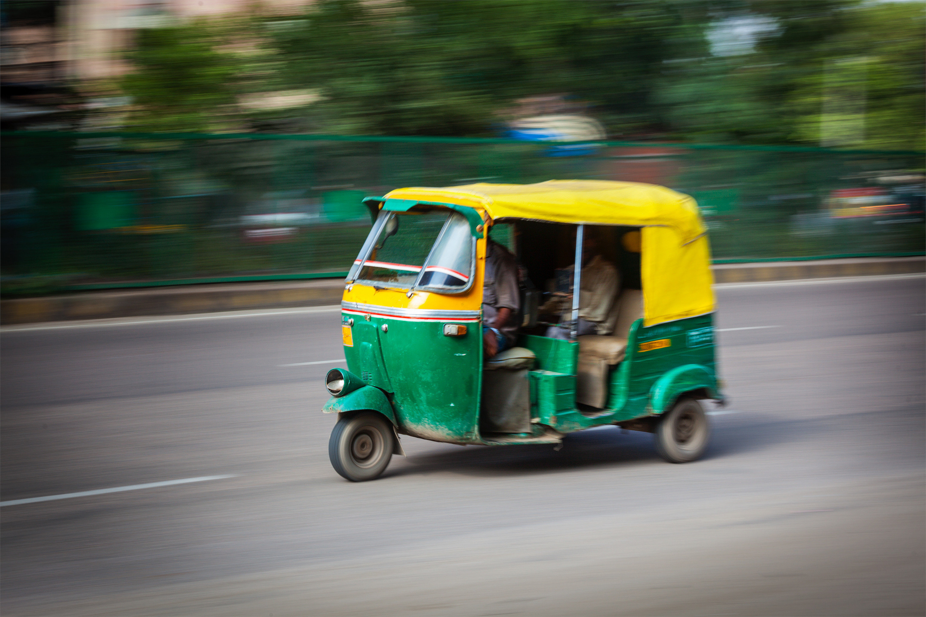 Travel Tips road outdoor green vehicle car yellow street driving transport mode of transport rickshaw cart Classic blue moving past golfcart