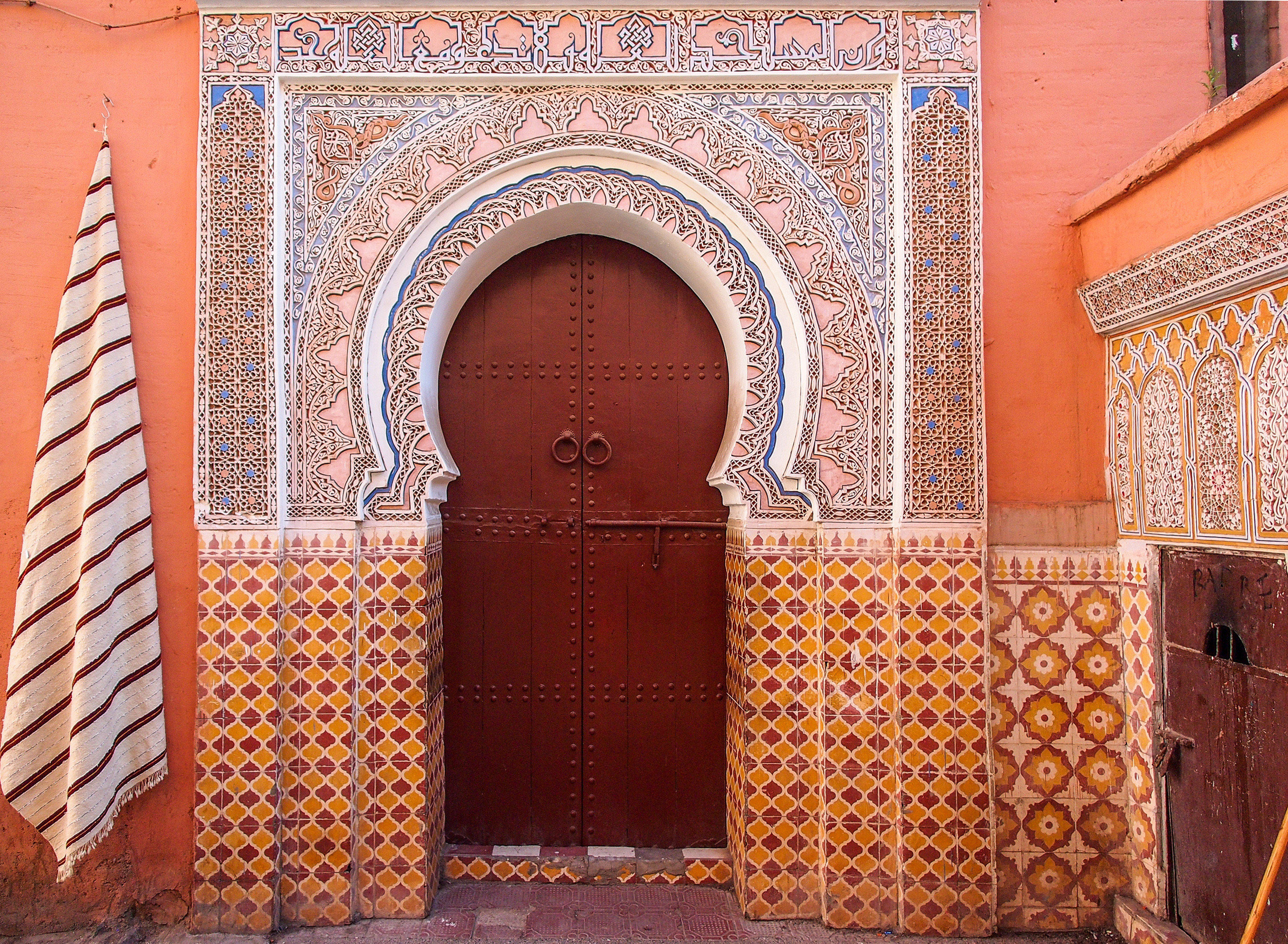 Arts + Culture Marrakech Morocco Style + Design arch wall Architecture brick brickwork door facade window building