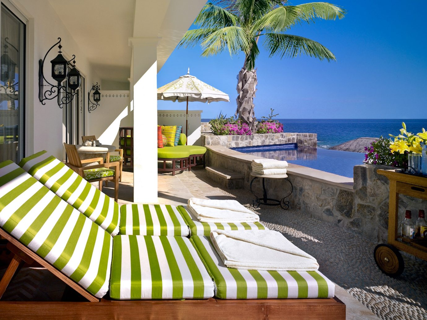 Beachfront Celebs Hotels Living Patio Pool Resort Trip Ideas leisure property outdoor room vacation estate home Villa condominium caribbean interior design swimming pool cottage decorated apartment hotel plant furniture lined