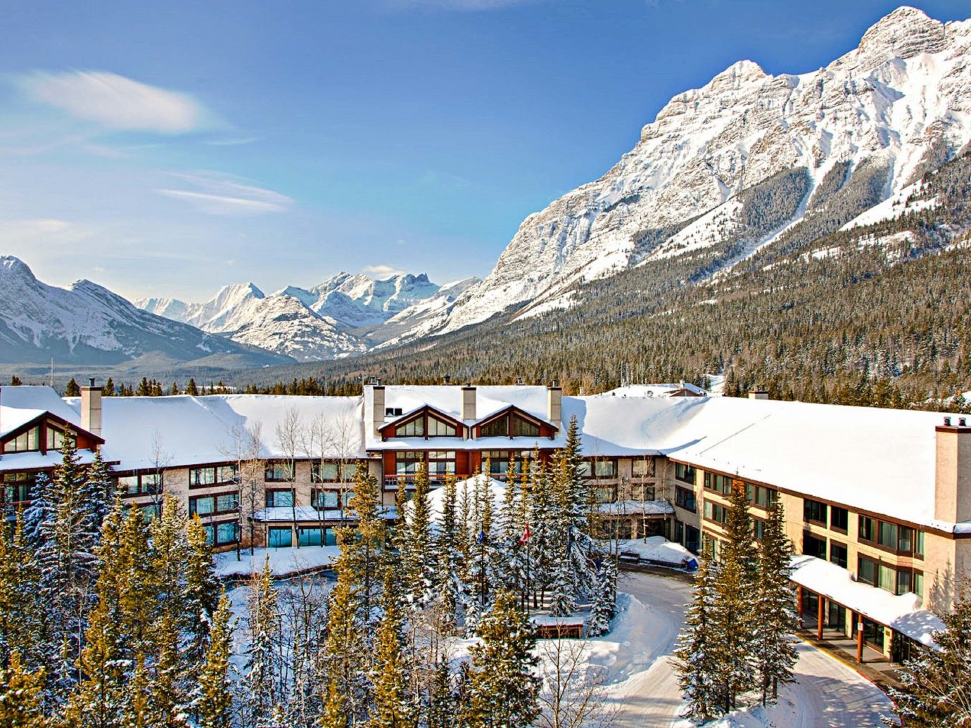 Alberta Boutique Hotels Canada Hotels Road Trips Winter mountain range mountainous landforms mountain snow sky alps tourist attraction real estate glacial landform reflection mount scenery tourism elevation tree vacation Lake roof landscape