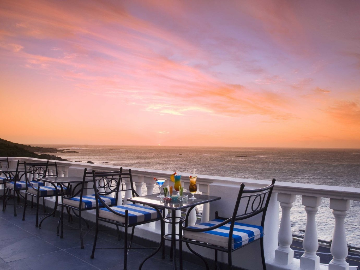 Hotels sky water outdoor Beach Sea Ocean horizon vacation Sunset Coast evening dusk bay shore sandy