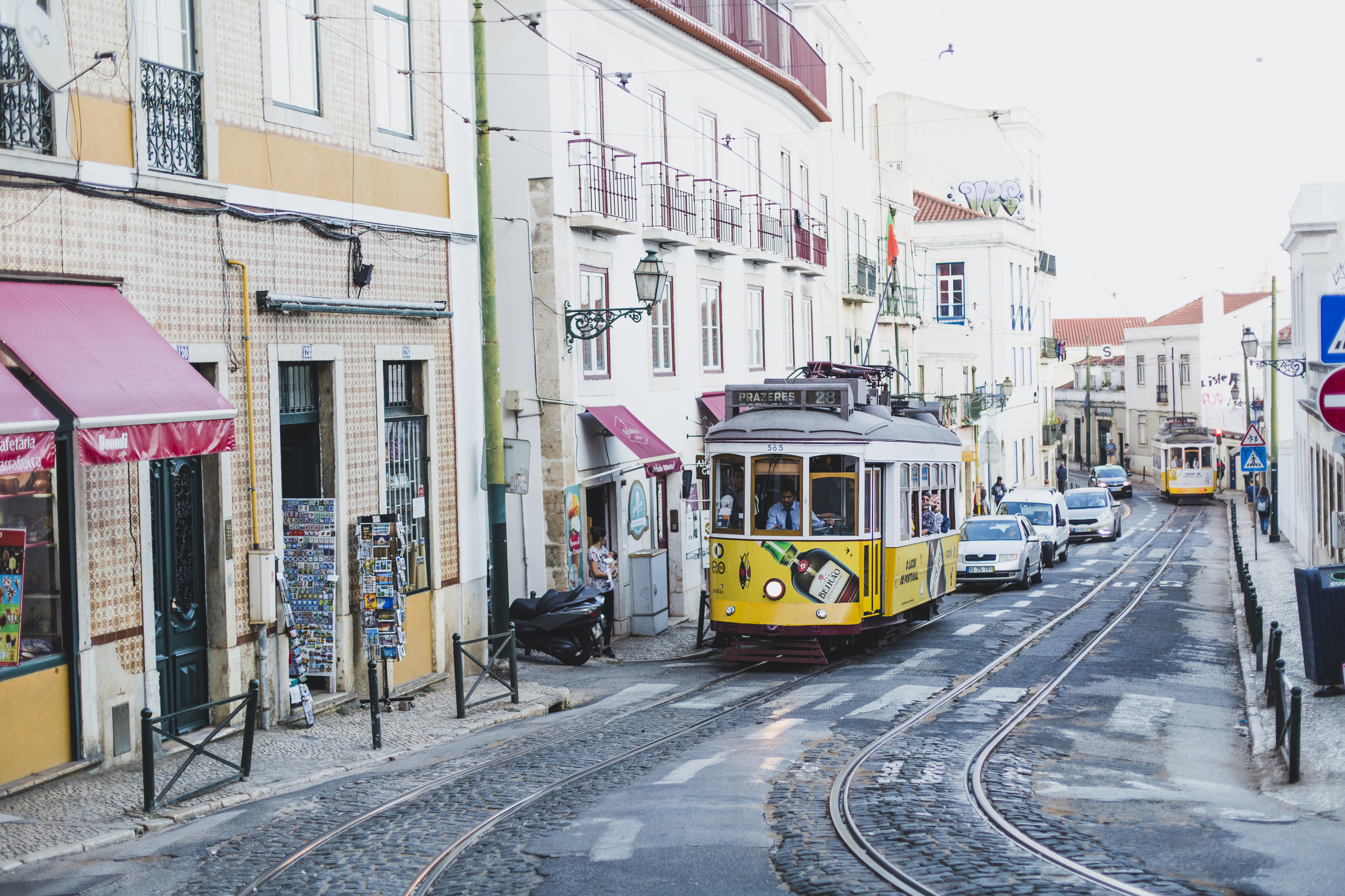 Lisbon Portugal Trip Ideas tram transport Town neighbourhood urban area electricity vehicle metropolitan area electrical supply City metropolis street cable car track town square Downtown public transport rolling stock Winter