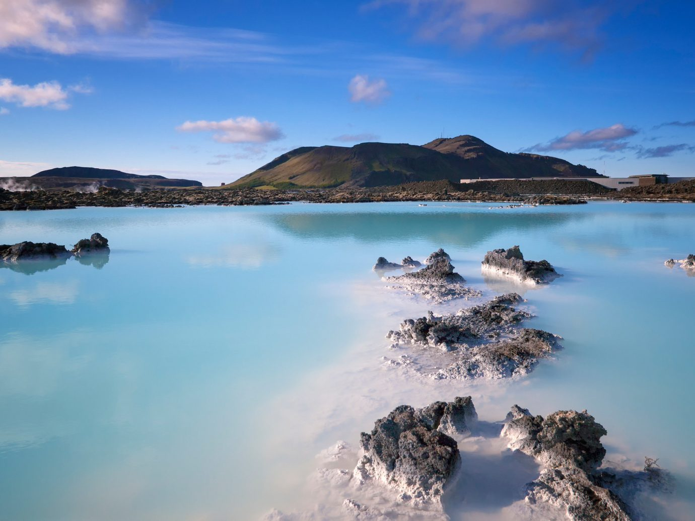 Hotels Iceland Lake Mountains Natural wonders Scenic views Travel Tips Trip Ideas sky water outdoor reflection Nature mountain cloud Sea body of water shore loch horizon Coast Ocean morning bay landscape reservoir dusk sunlight dawn Lagoon Beach Island surrounded clouds promontory day