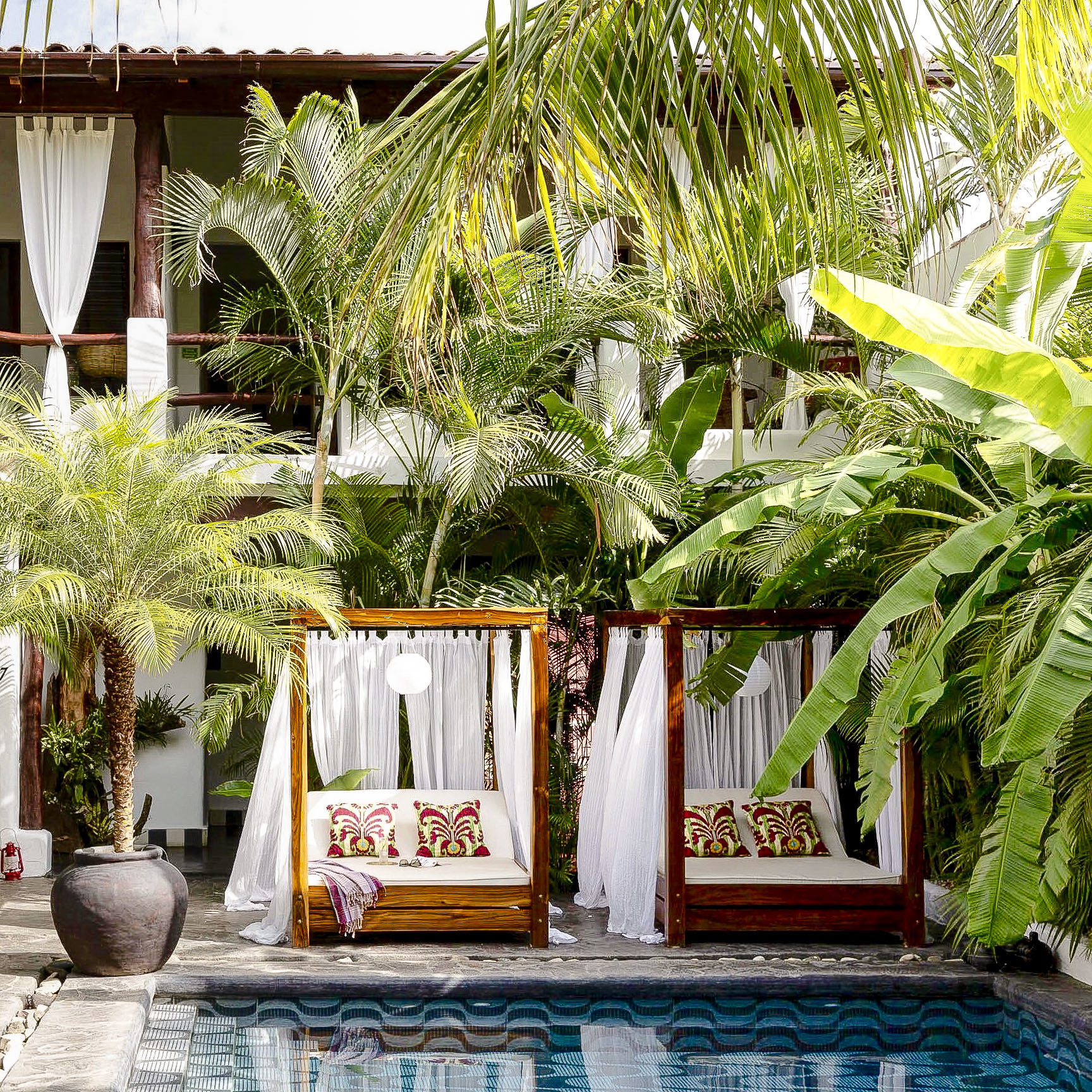 Boutique Hotels Hotels property plant arecales palm tree tree Resort outdoor structure house