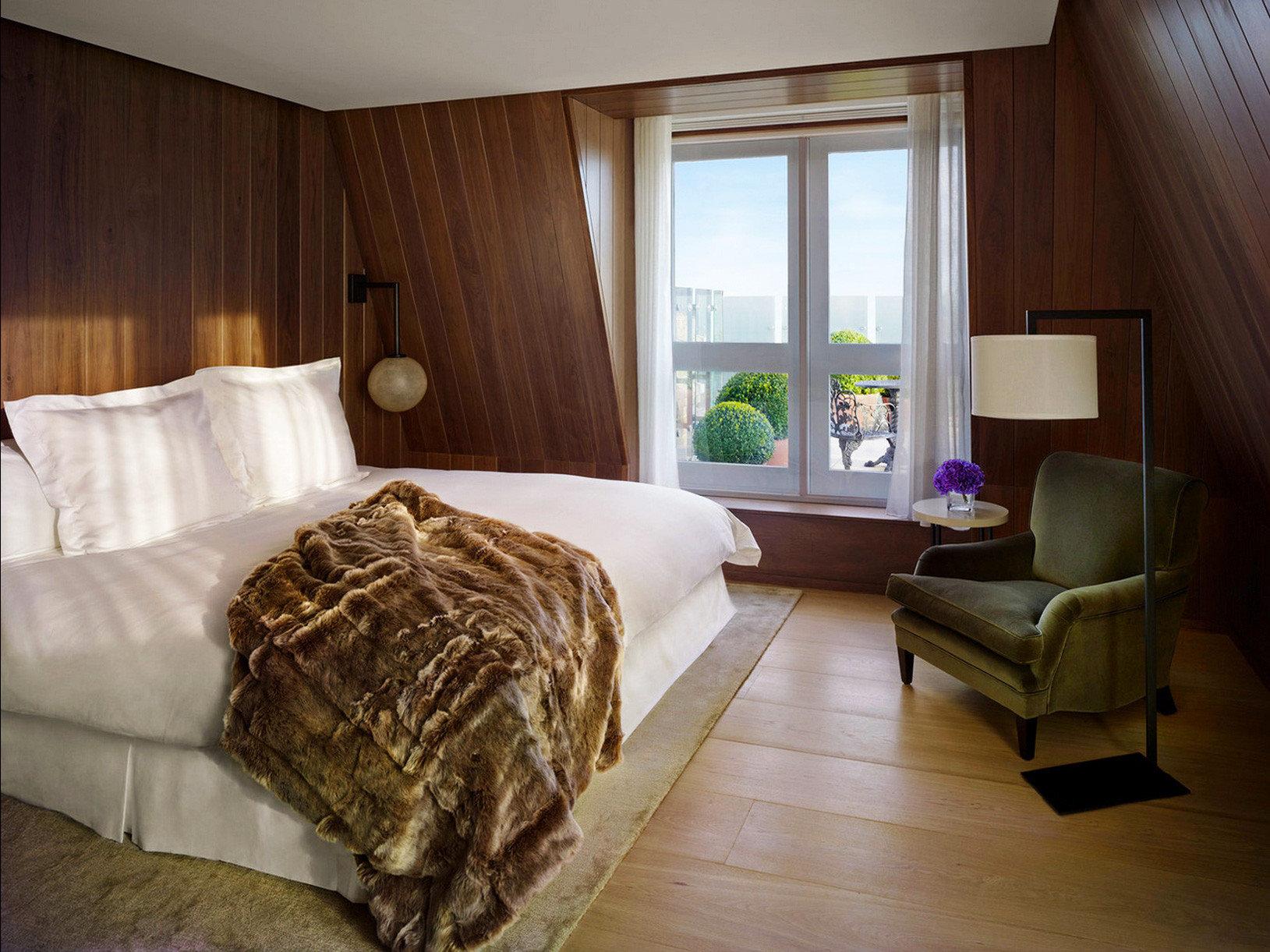 Bedroom Elegant Hip Hotels Luxury Modern Suite indoor floor wall bed room property house home hardwood cottage furniture estate interior design real estate bed sheet apartment
