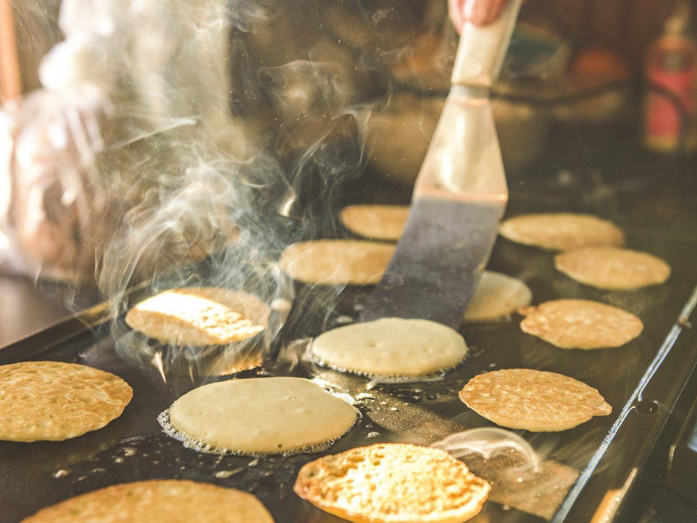 Health + Wellness Meditation Retreats Trip Ideas Yoga Retreats person human action dish indoor food meal cooking kitchenware baking breakfast sense cuisine grill griddle