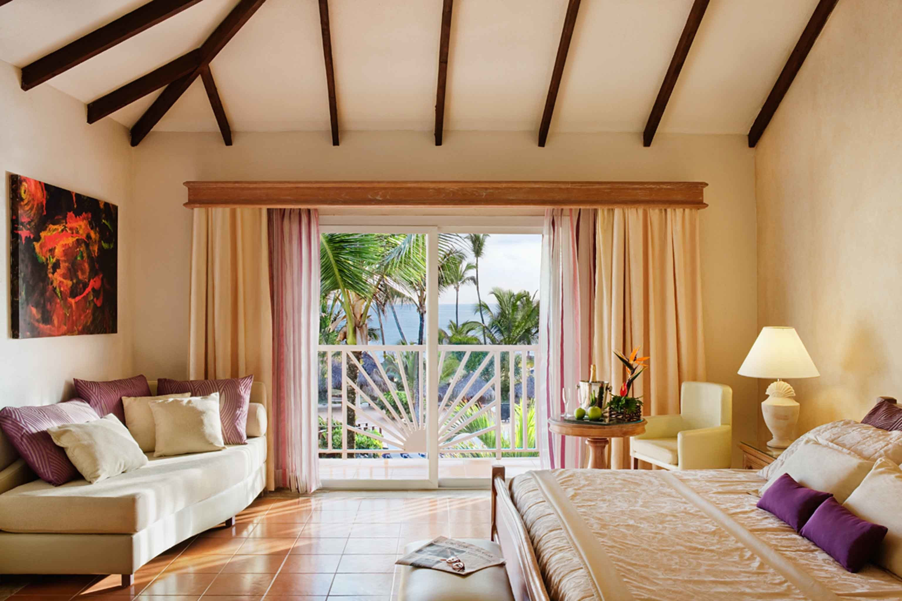 All-Inclusive Resorts Balcony Bedroom Hotels Romance Scenic views Suite indoor wall room sofa floor Living property estate living room decorated cottage home interior design furniture real estate farmhouse Villa ceiling nice colored