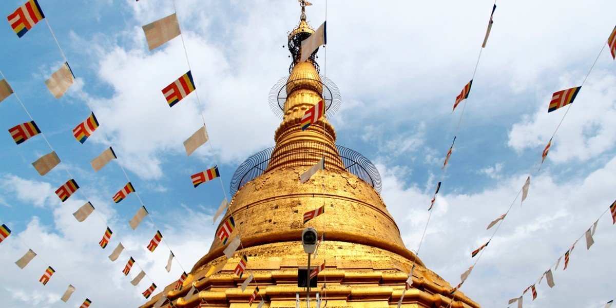 Trip Ideas sky outdoor landmark tower stupa pagoda wat temple place of worship spire colored