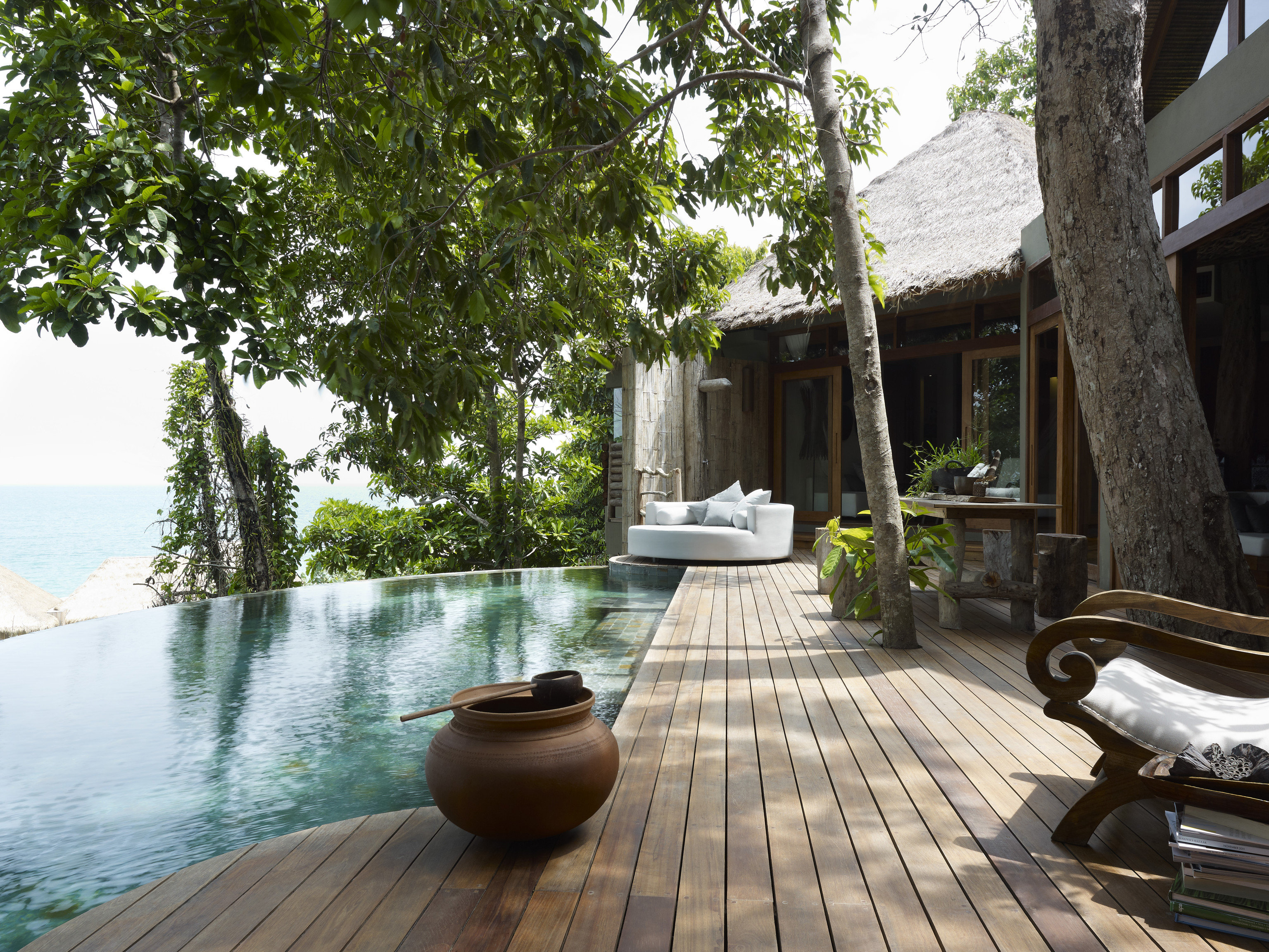 Hotels tree outdoor property estate swimming pool vacation home Resort backyard Courtyard wooden cottage Villa outdoor structure stone