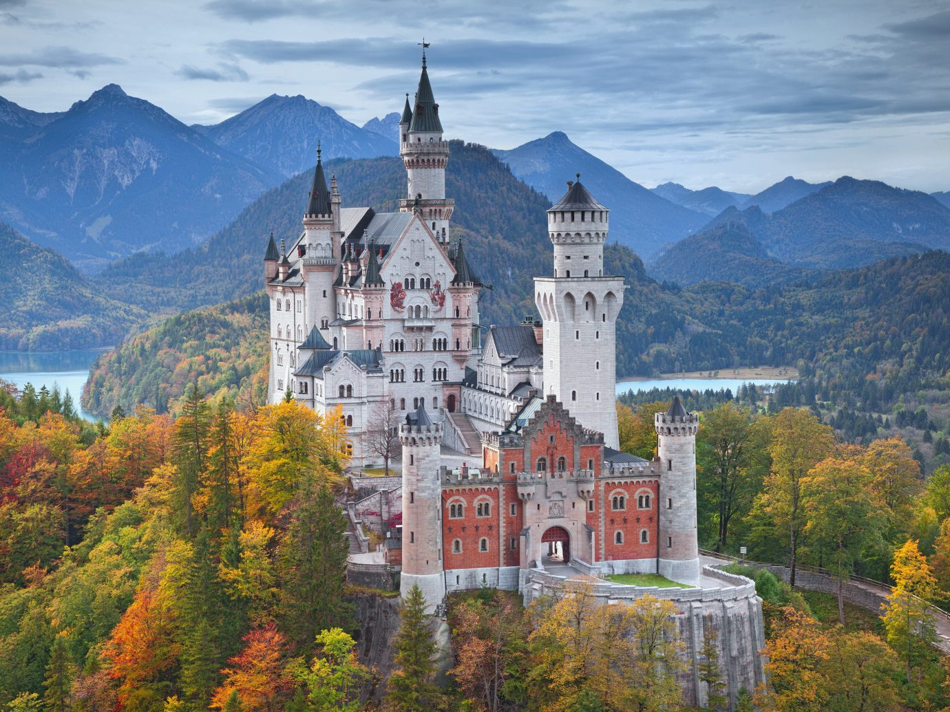 Offbeat Trip Ideas mountain tree outdoor mountainous landforms château castle mountain range Town landmark building season background autumn tourism alps monastery surrounded Forest hillside lush