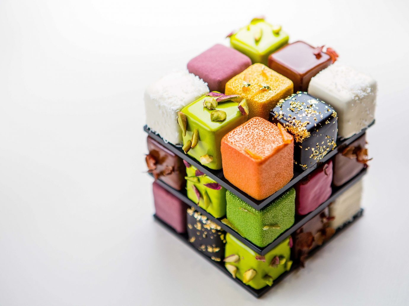 europe Trip Ideas cake indoor toy sweetness product petit four confectionery product design food decorated square colored
