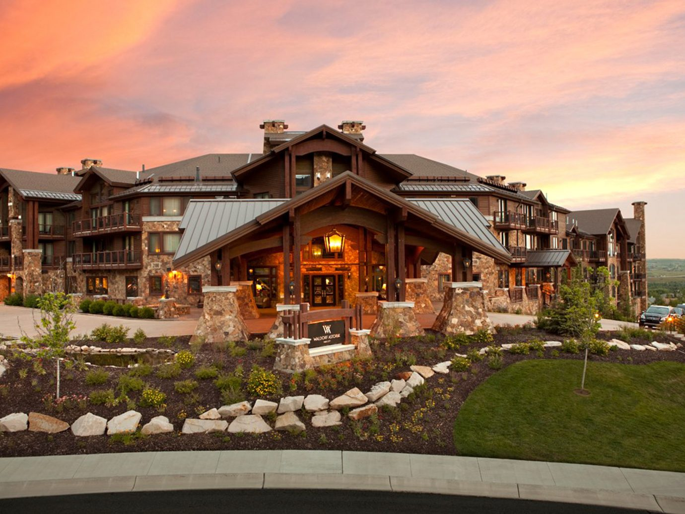 Architecture Buildings Exterior Mountains Trip Ideas sky outdoor grass house estate Town home residential area building neighbourhood vacation suburb mansion landscape facade Village Resort stone