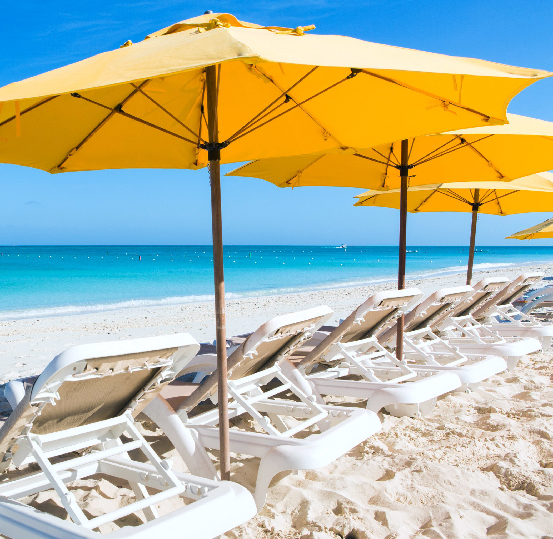 Beach Beachfront Grounds Hotels Play Resort Scenic views accessory sky umbrella outdoor chair shore Ocean Nature Sea caribbean Coast vacation
