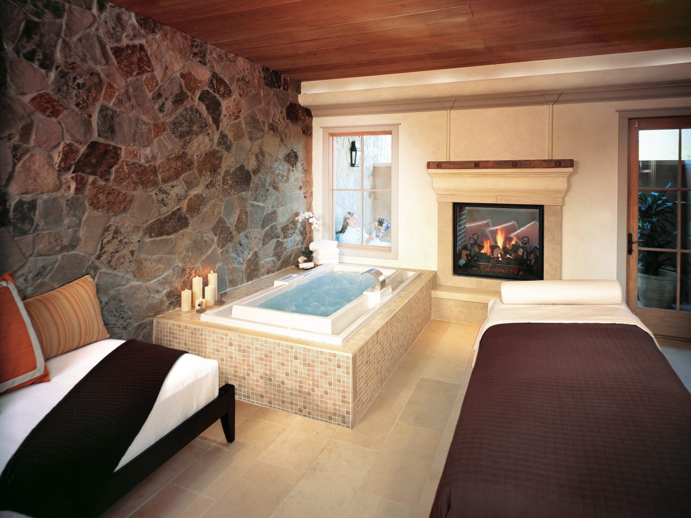 Bath Hotels Luxury Romance Spa Spa Retreats Trip Ideas indoor sofa room wall floor Living ceiling property house Fireplace estate living room home hardwood interior design furniture cottage wood Suite Design real estate stone wood flooring mansion decorated