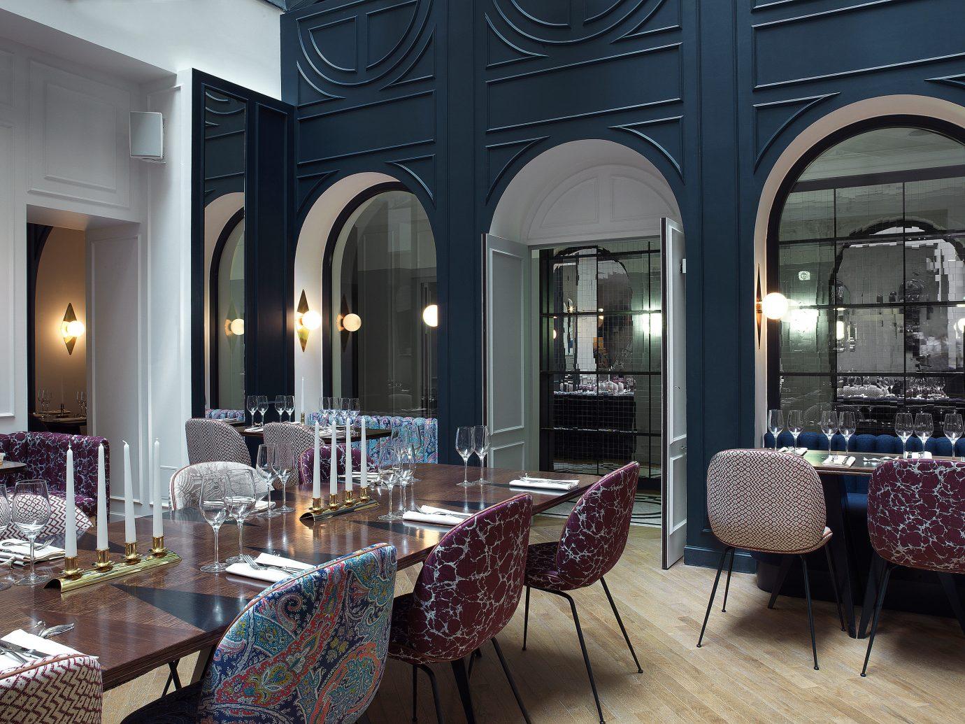 Boutique Hotels Hotels floor indoor chair room Lobby restaurant estate interior design dining room Design meal living room area furniture several