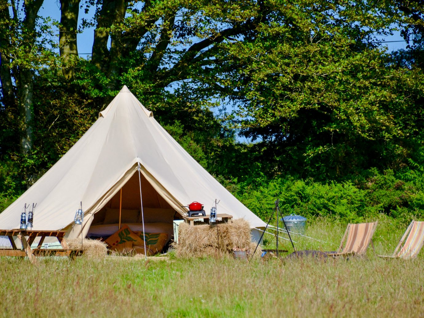 Glamping Outdoors + Adventure Trip Ideas tree grass outdoor tent outdoor object camping hut cottage yurt national park sky landscape recreation lush